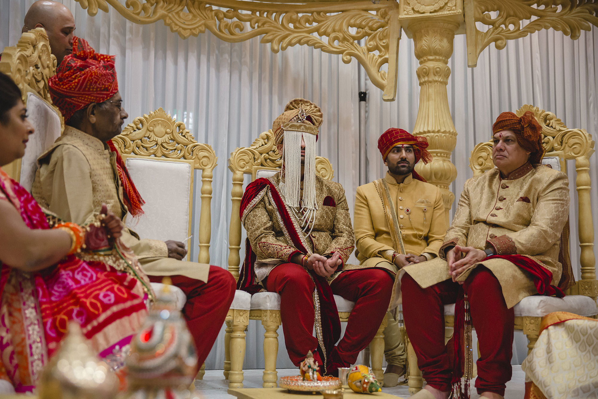 groom sitting in the mandap during his wedding