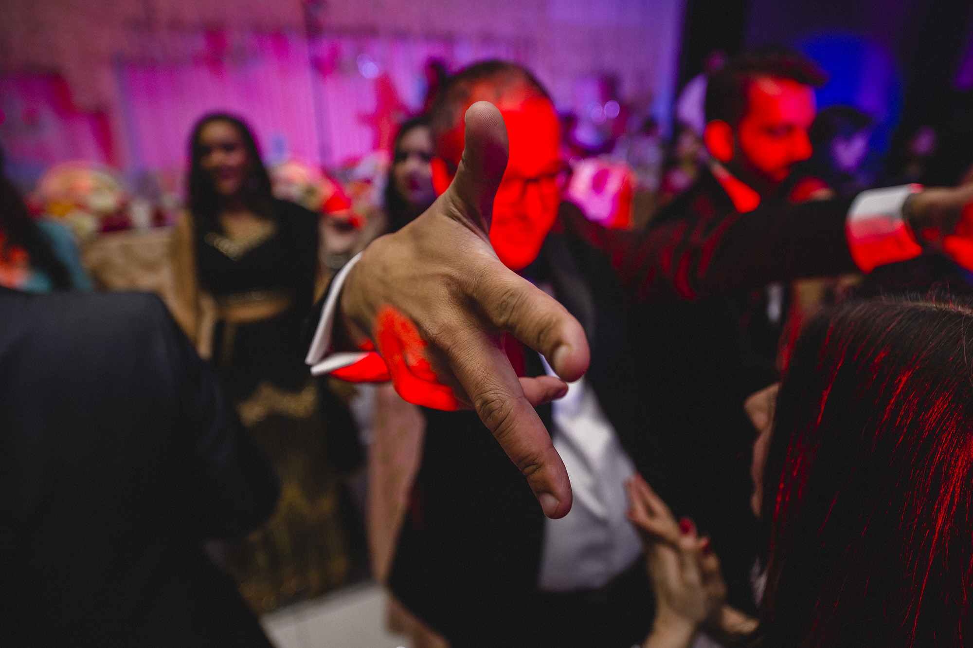 close up of guests hand while partying