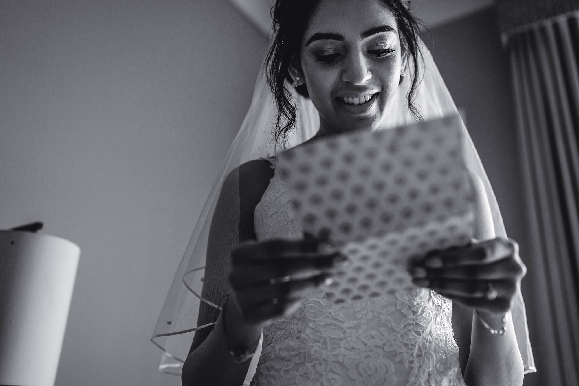 bride reading card from the groom prior to her civil wedding