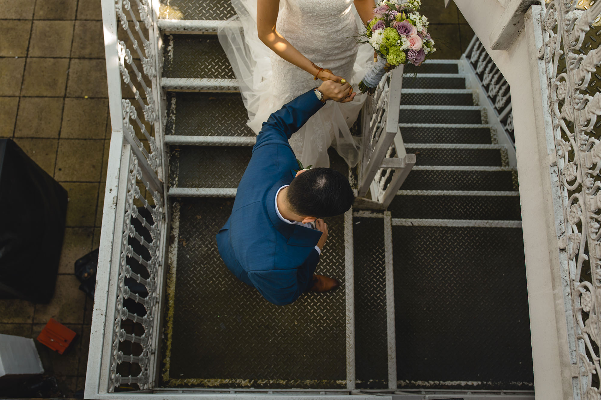 bride and groom walking down the stairs at the belfry