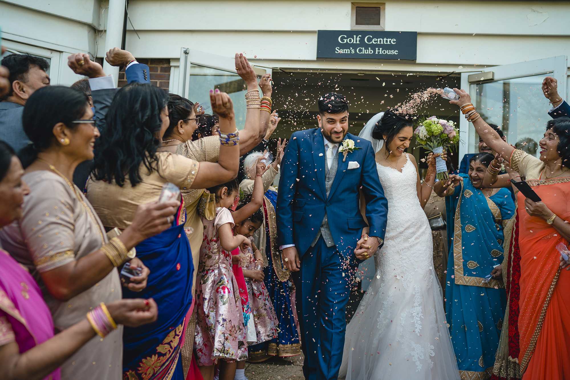bride and groom and confetti at the belfry