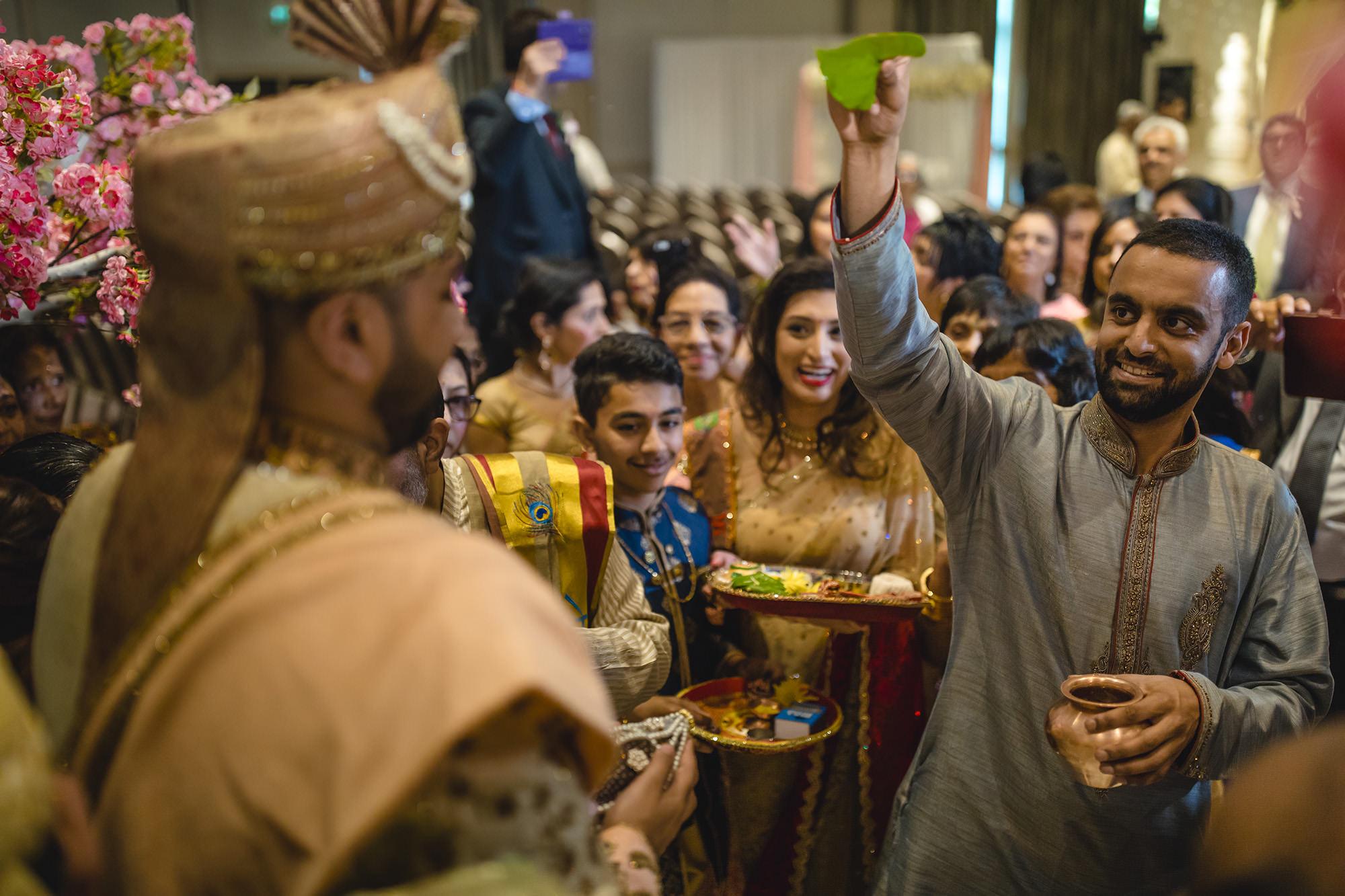 welcoming the groom to the hindu wedding