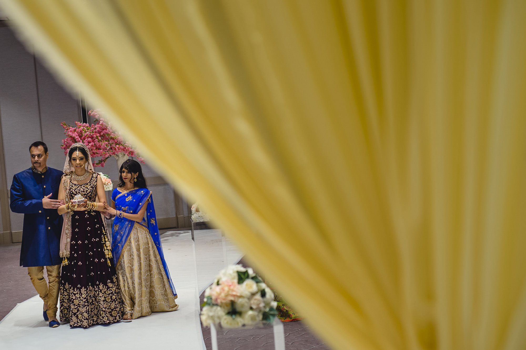 bride making her way to the mandap at the Belfry