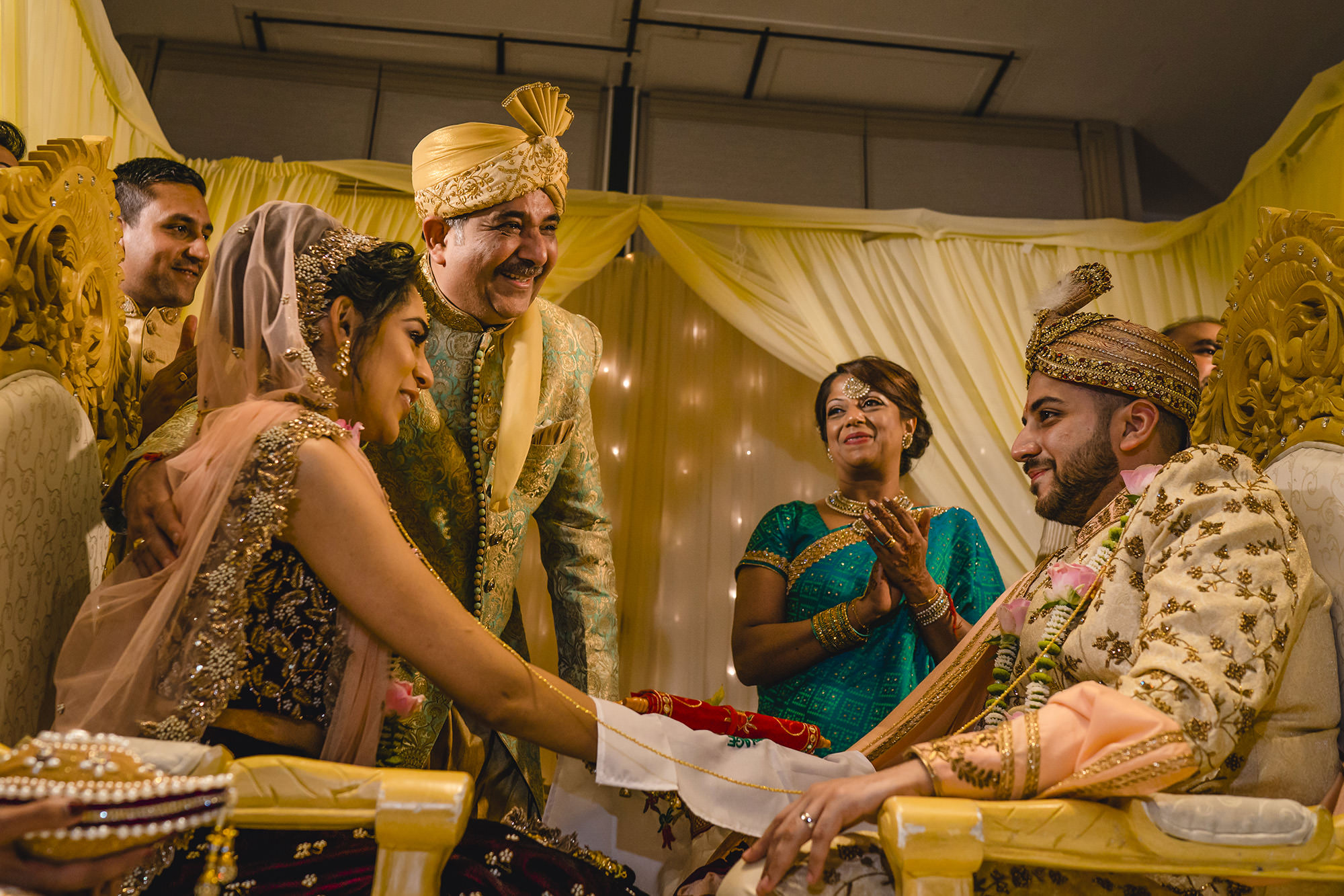 hindu wedding ceremony with the grooms parents