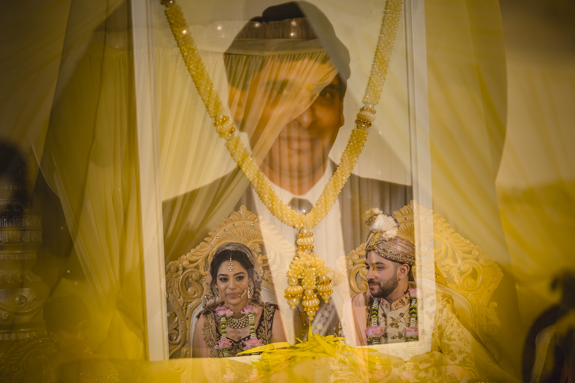 multiple exposure of the brides father and the couple