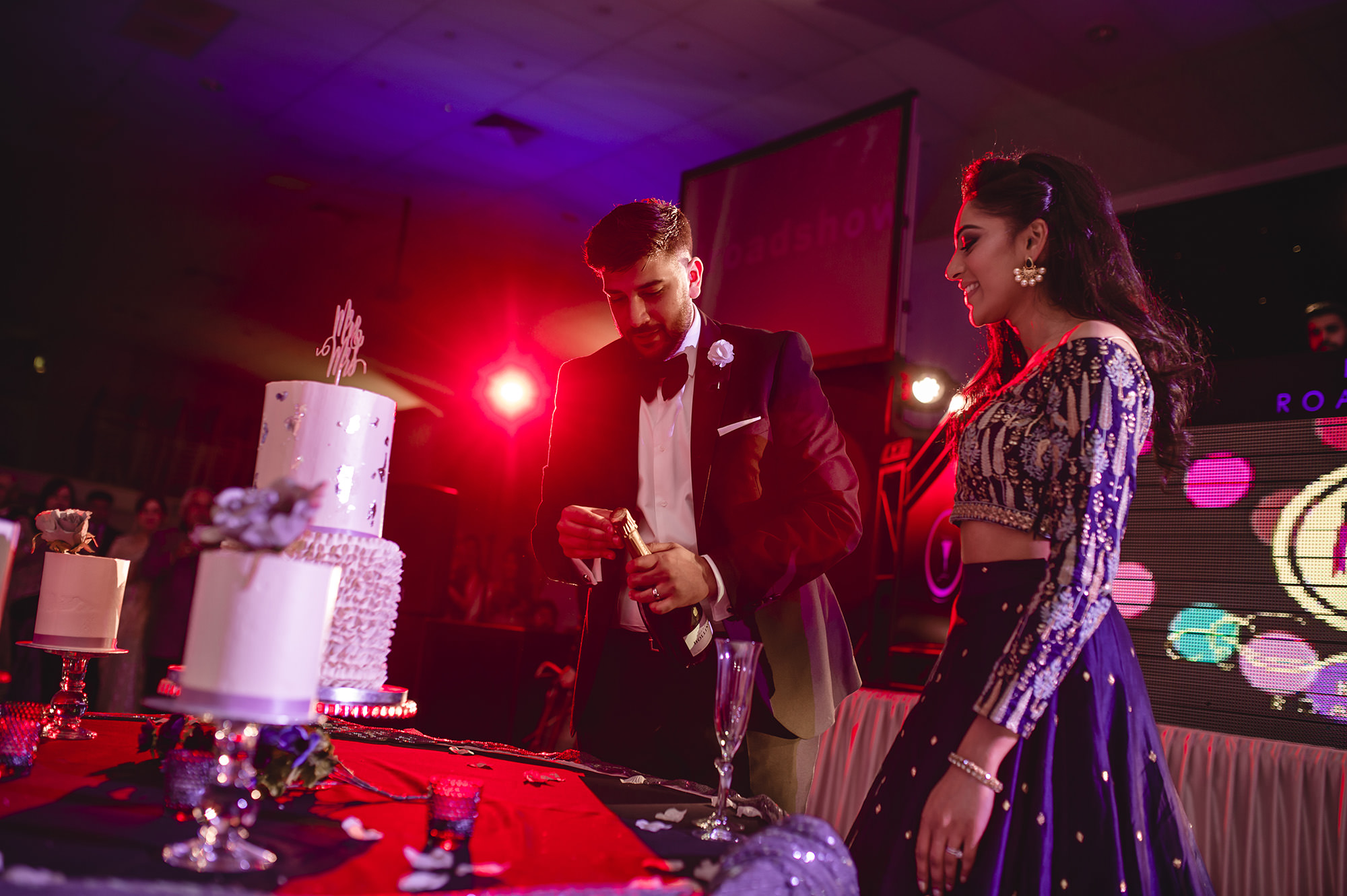 bride and groom opening champagne to celebrate