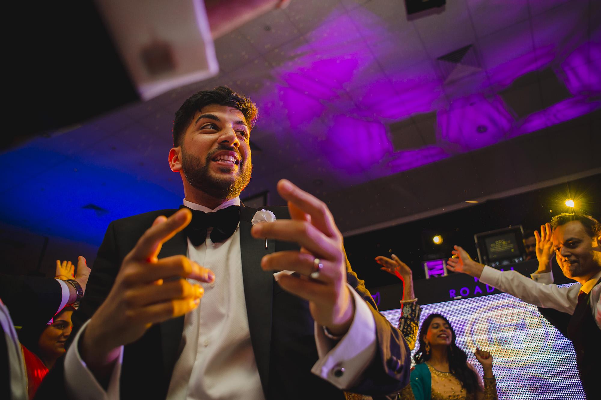 groom partying on the dancefloor