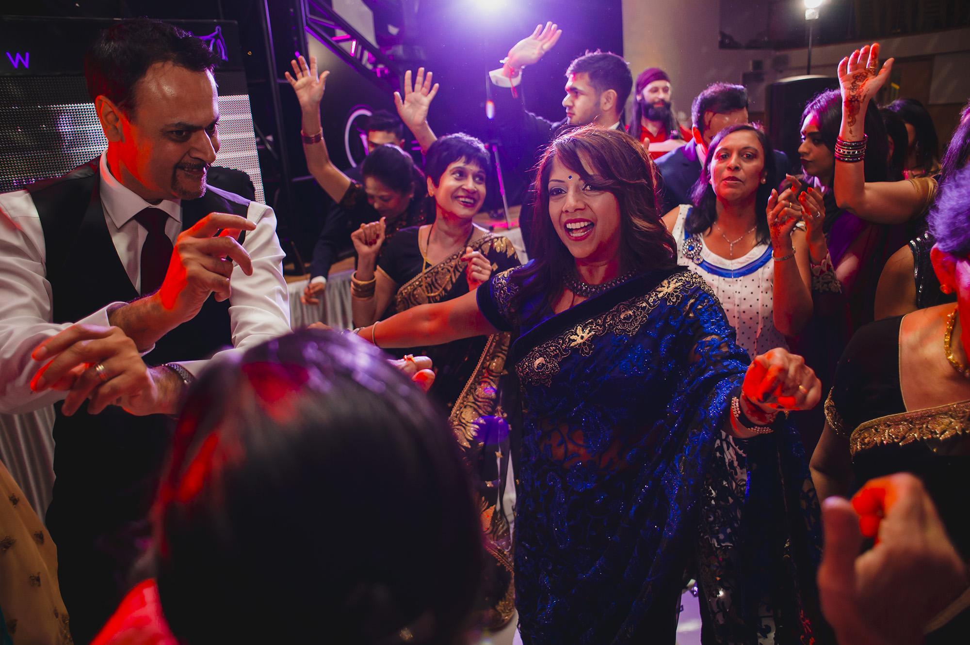 family dancing around mum during the wedding reception