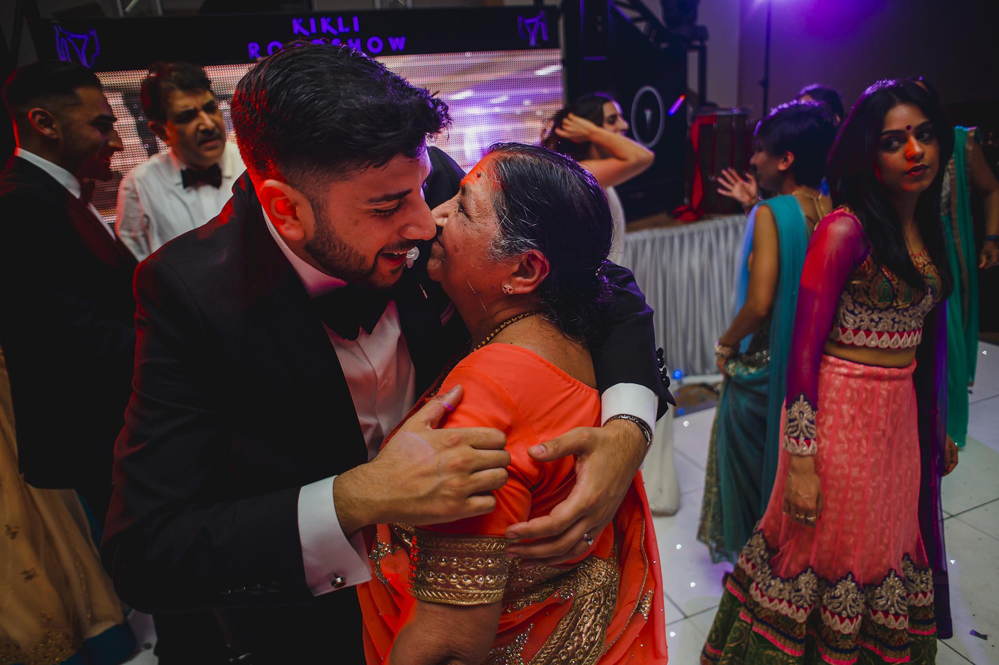groom hugging his gran on the dancefloor