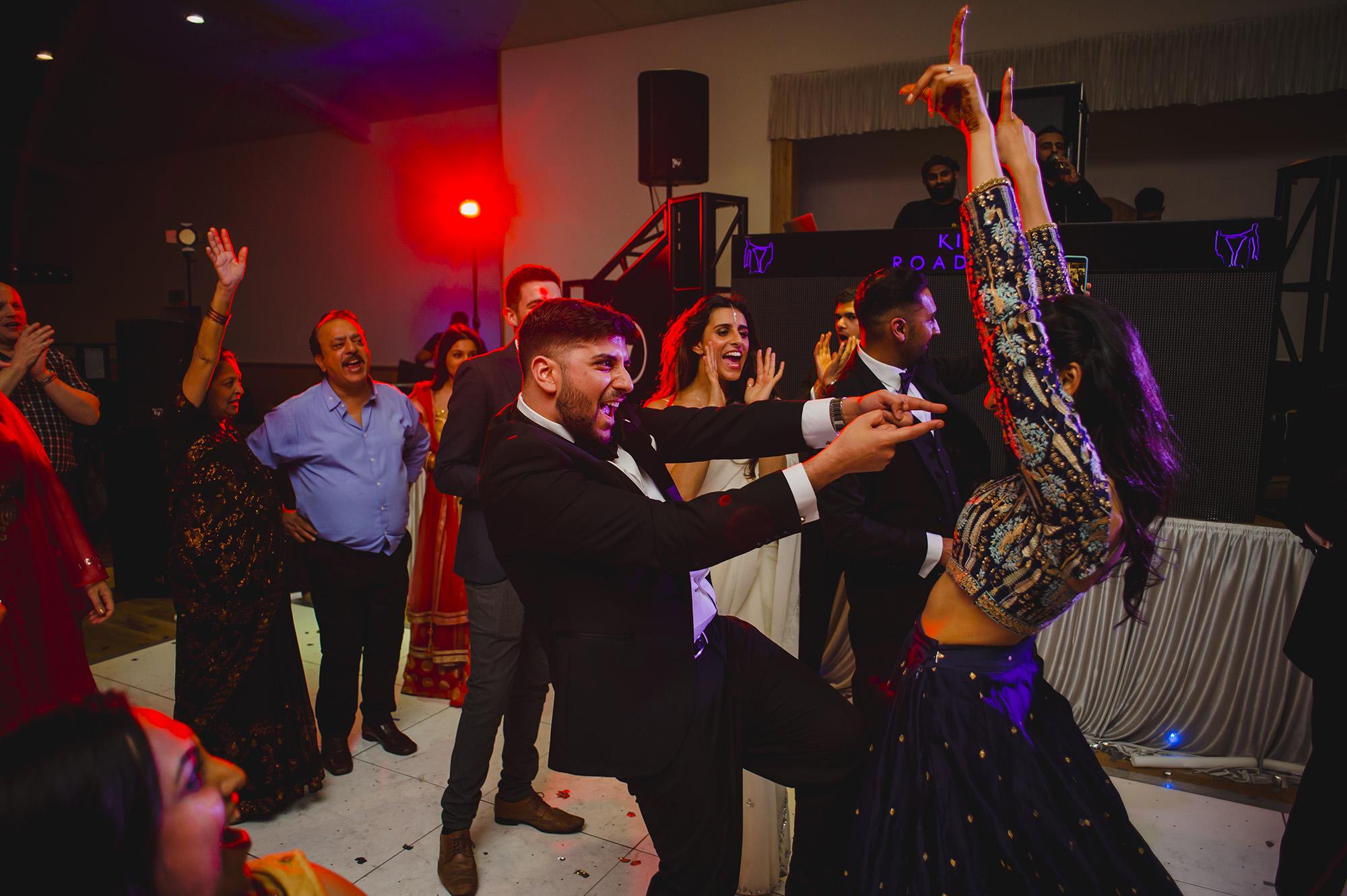 bride and groom celebrating on the dancefloor