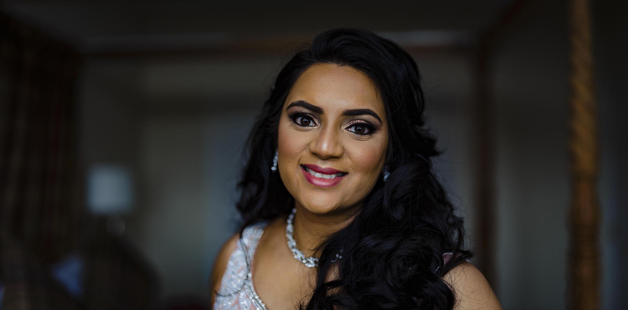 bridal portrait in her wedding dress at froyle park
