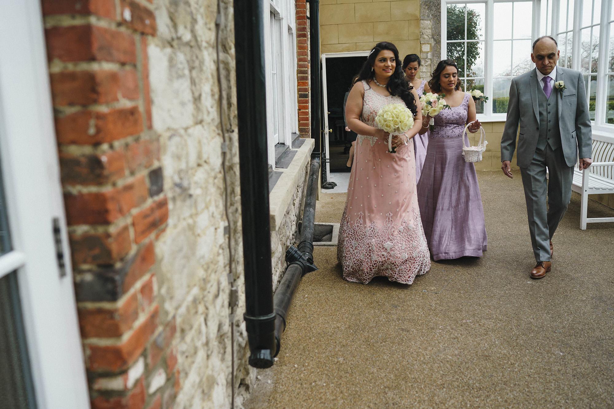 bride walking to her wedding ceremony