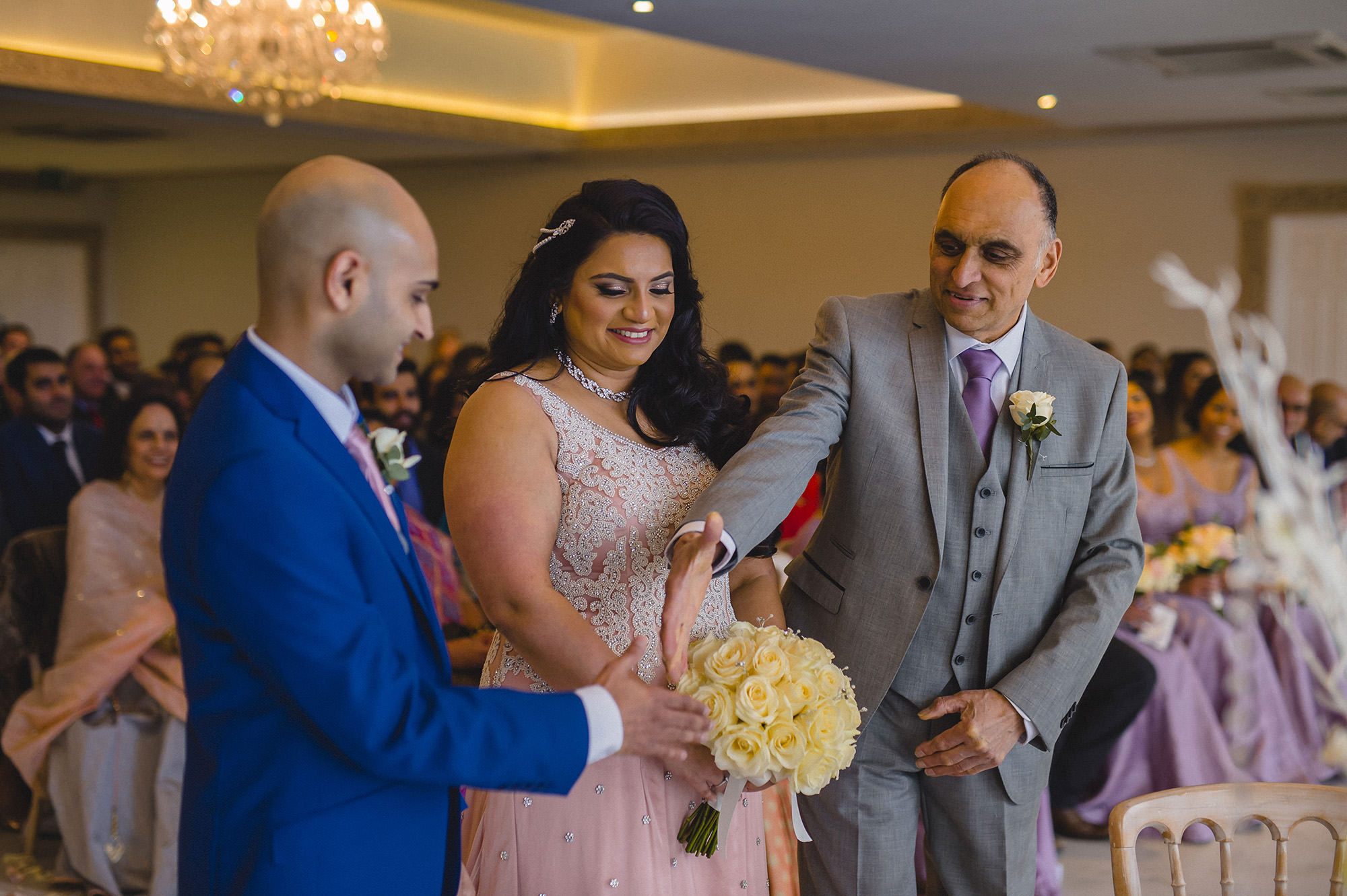 father of the bride shaking hands with groom at wedding ceremony