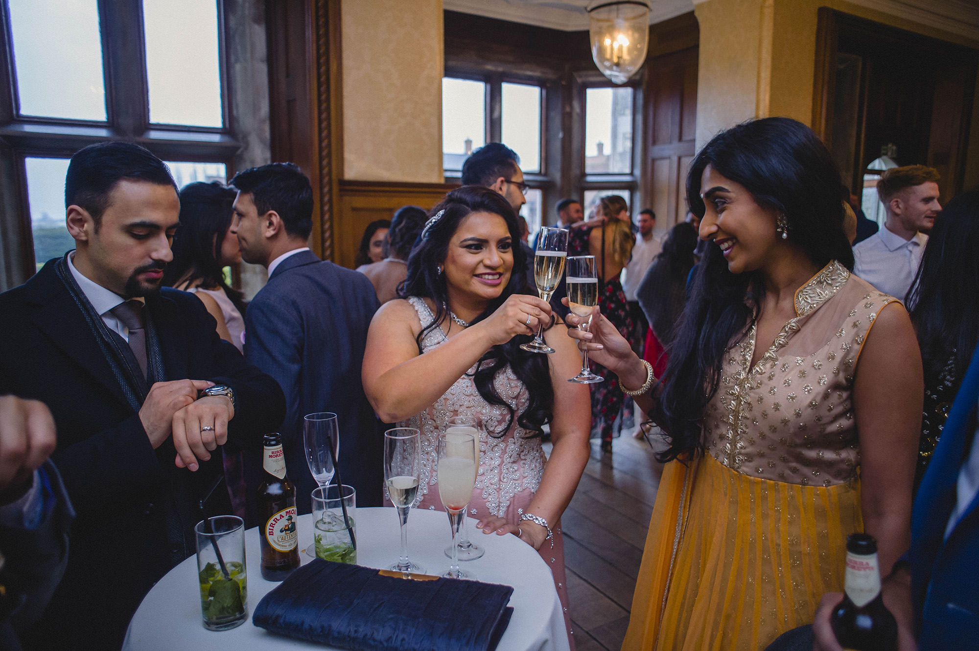 bride enjoying champagne reception with friends and family