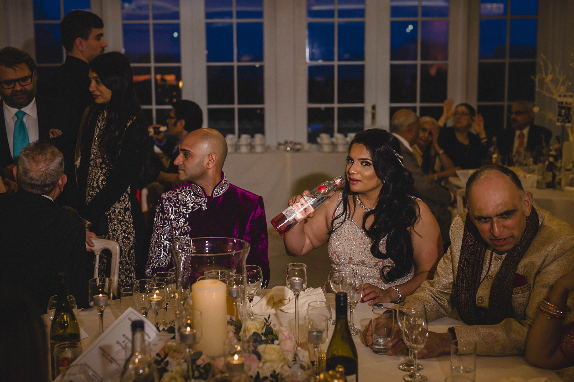 bride drinking vodka during her wedding reception