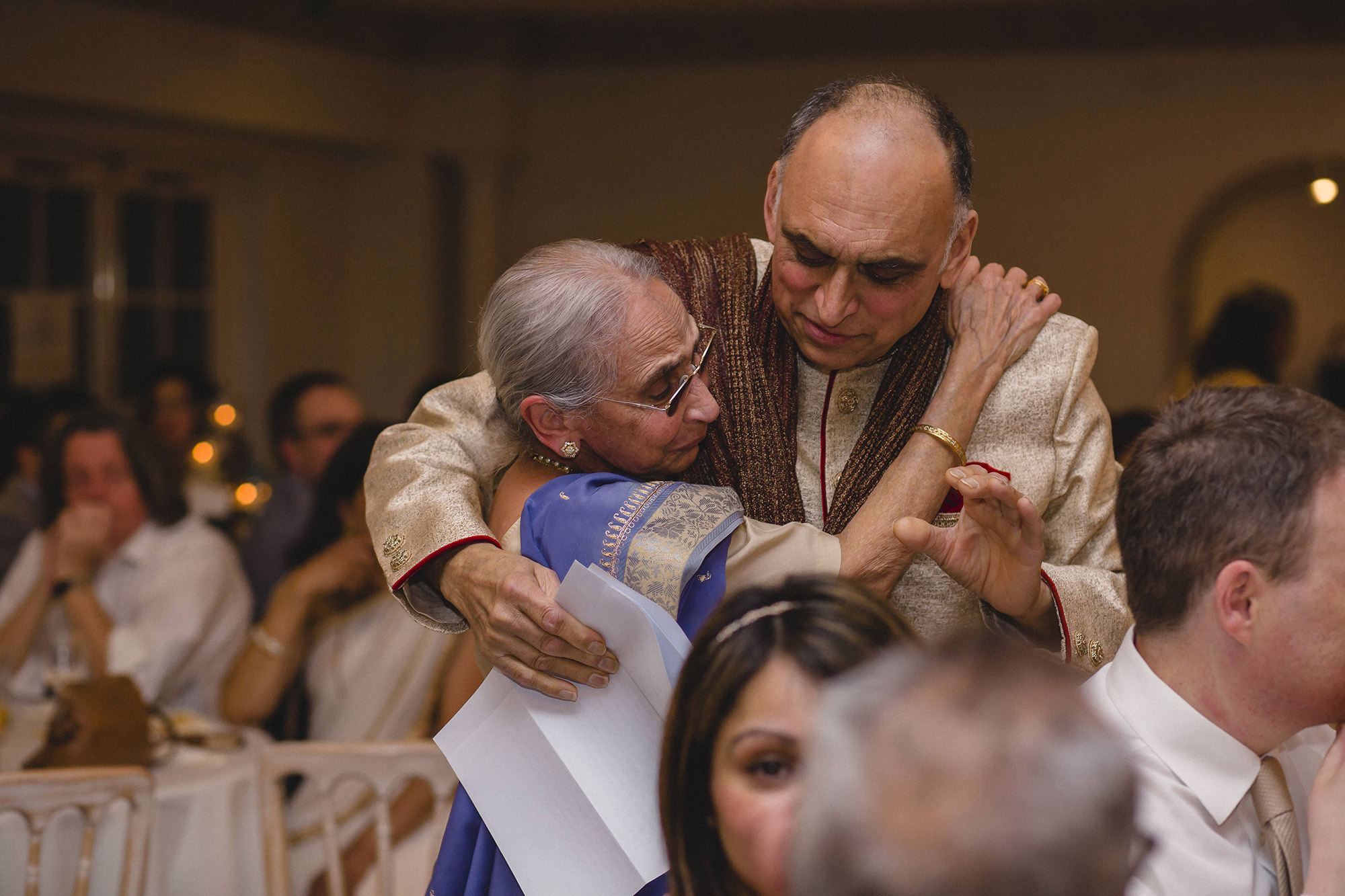 father of the bride hugging grandmother