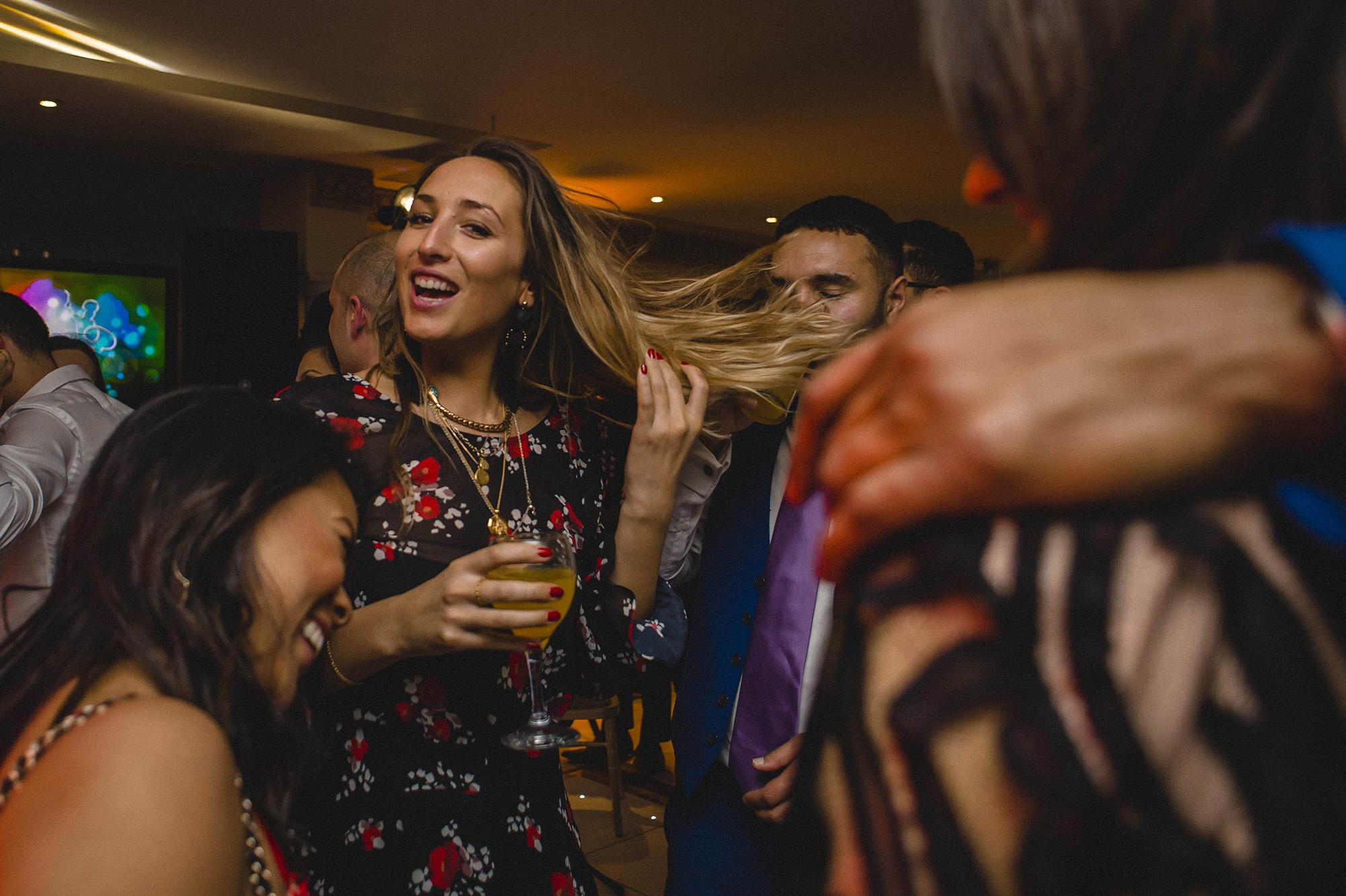 friends having fun at froyle park wedding reception