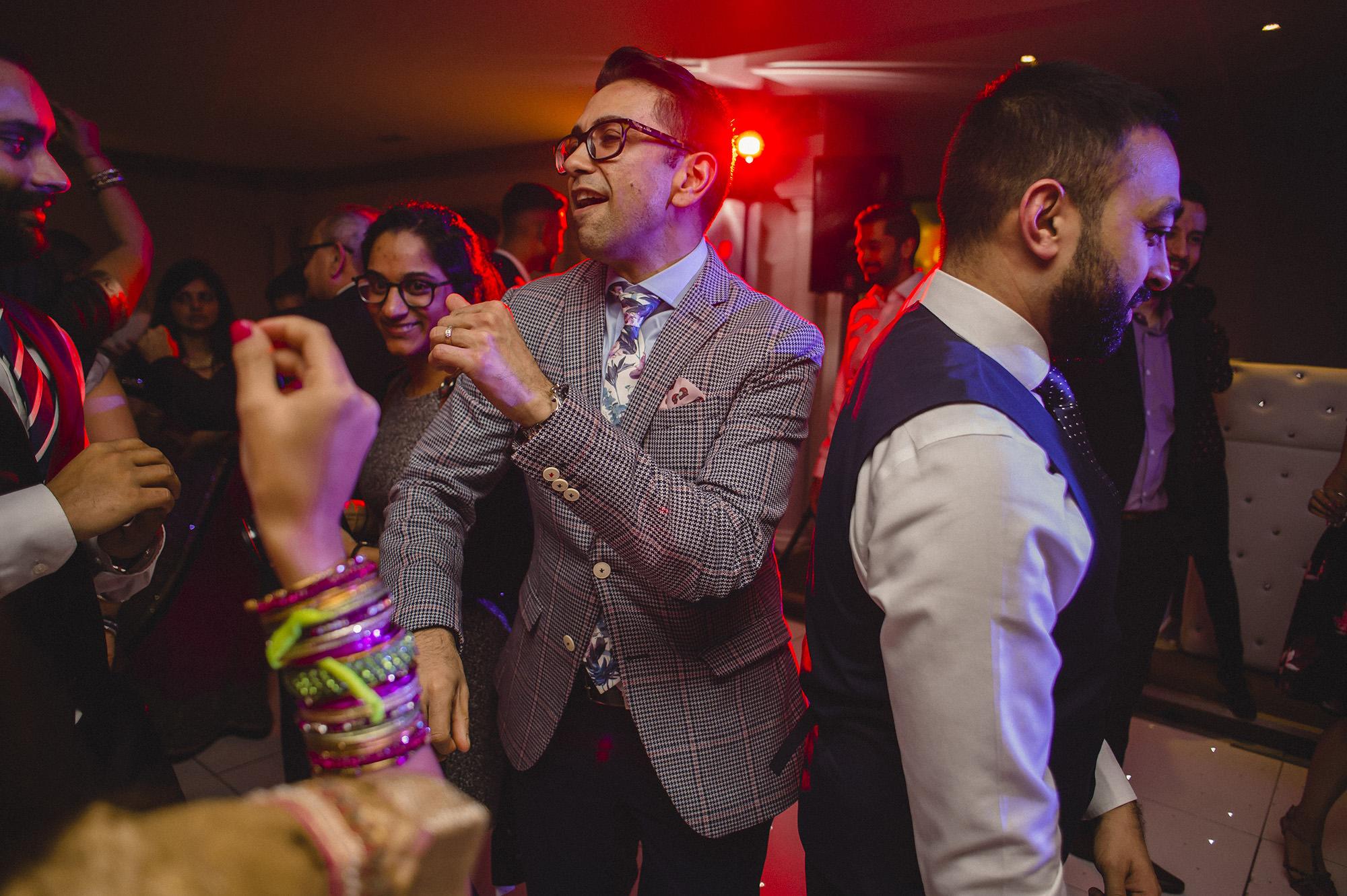 wedding guest dancing at wedding reception