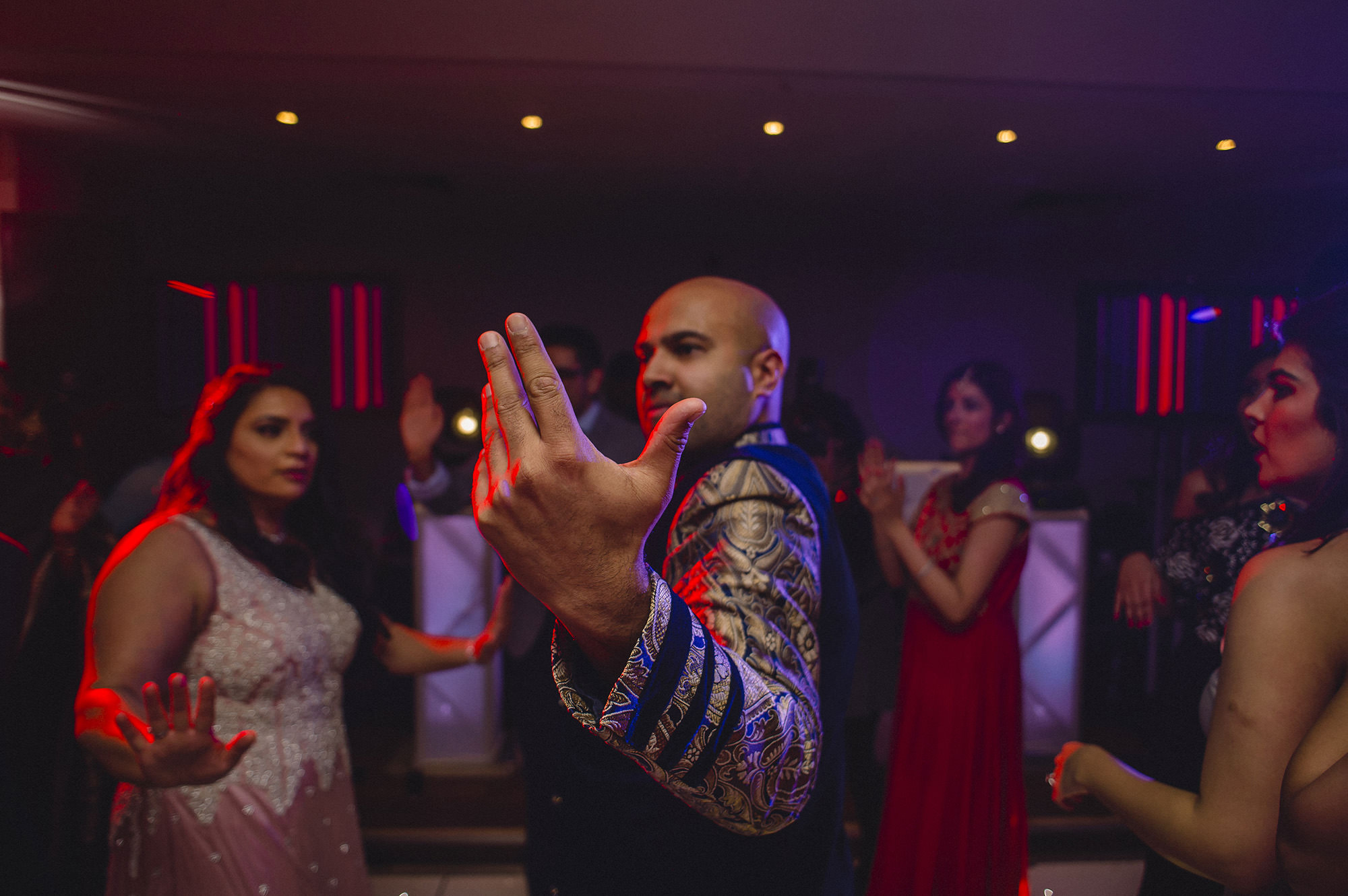 groom dancing with friends at his wedding reception