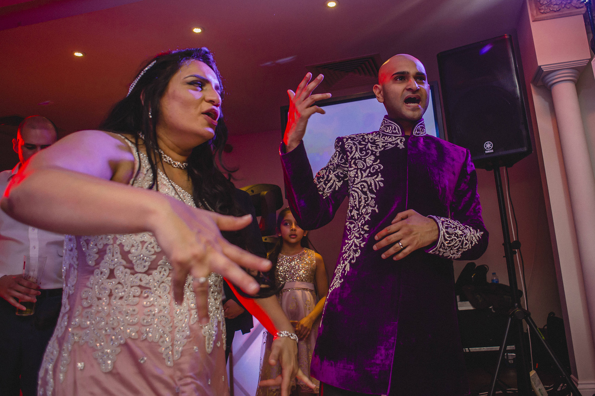 bride and groom partying at their wedding reception