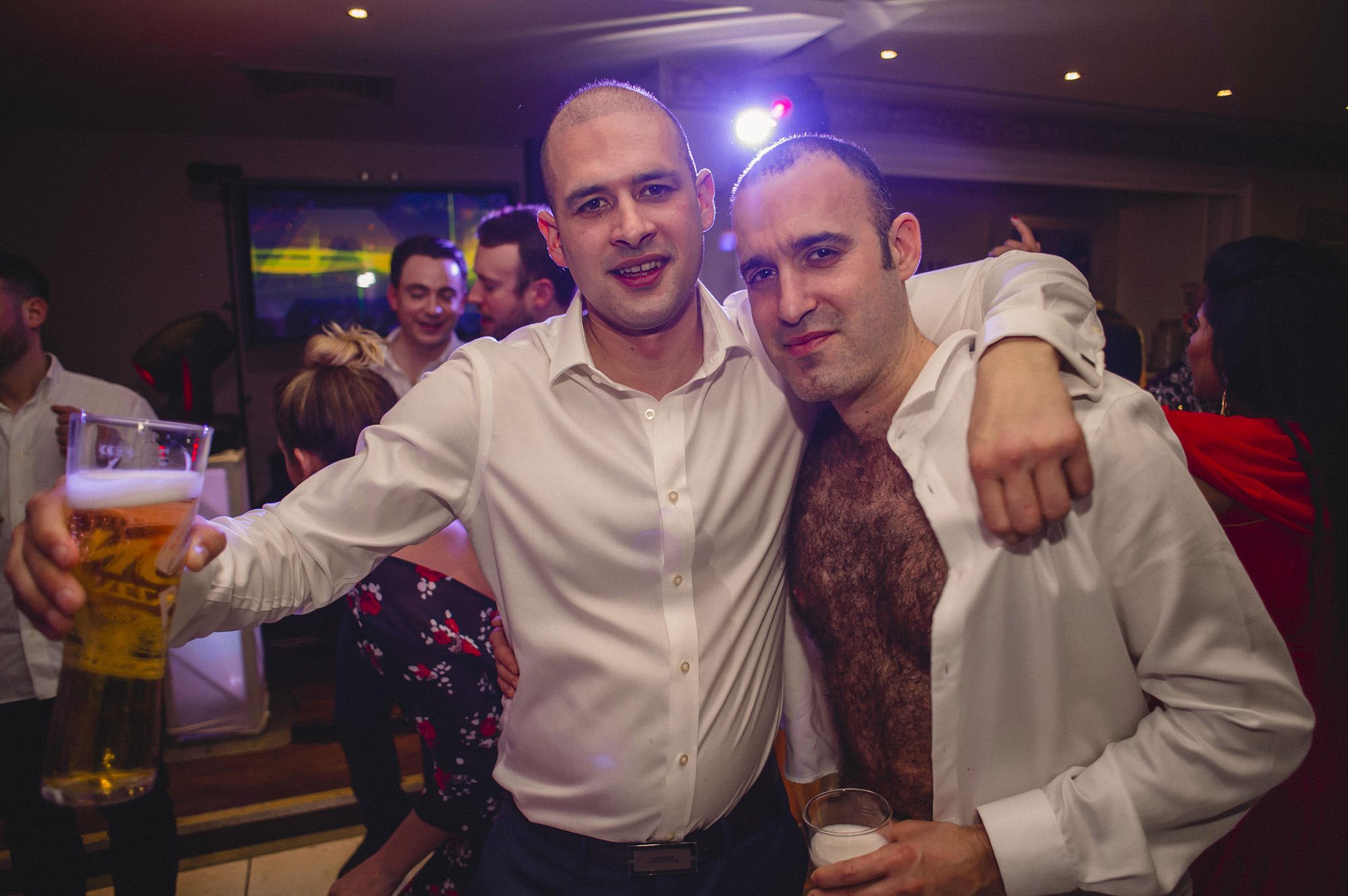 friends partying at wedding reception