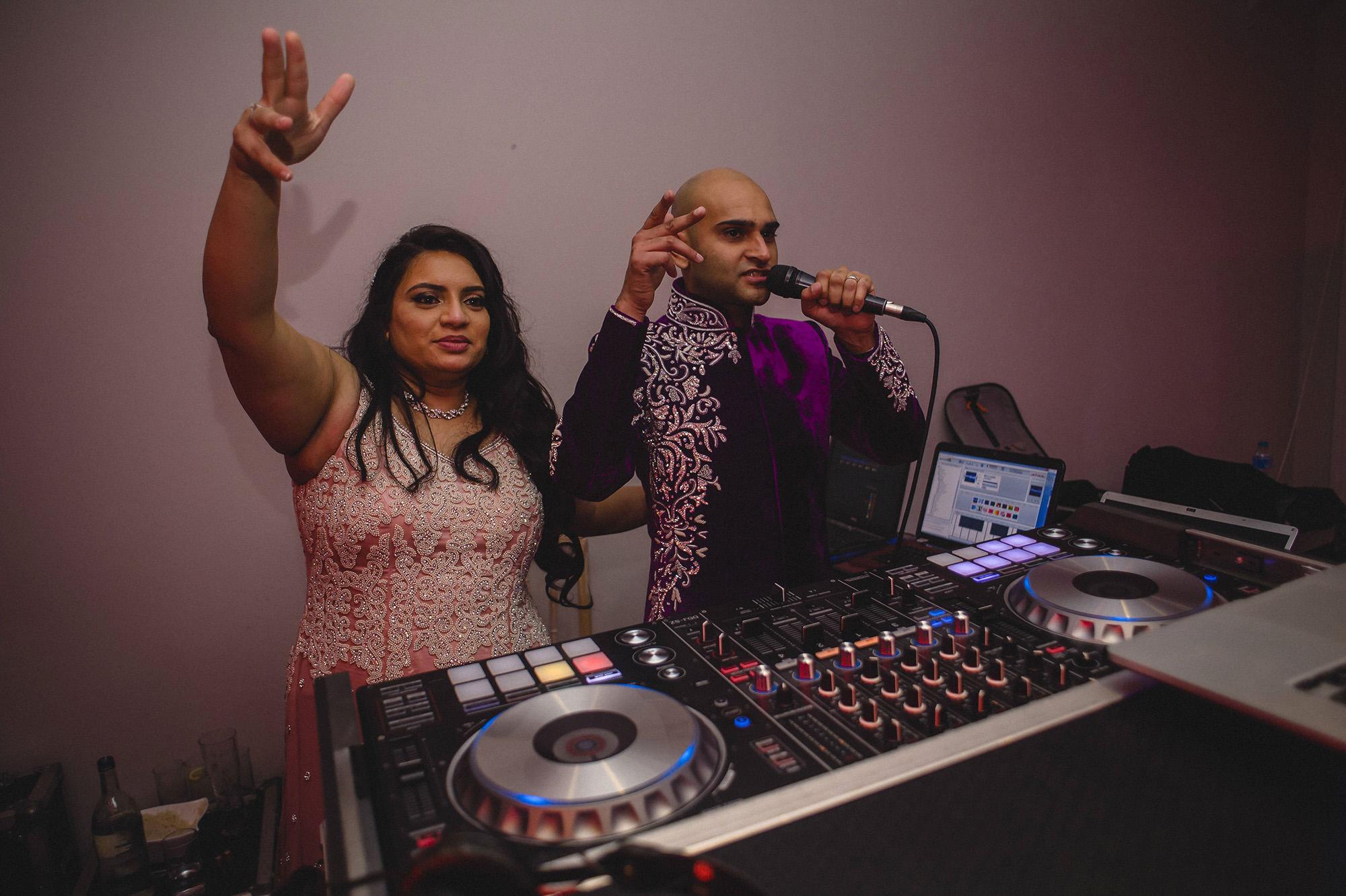 bride and groom using the DJ decks