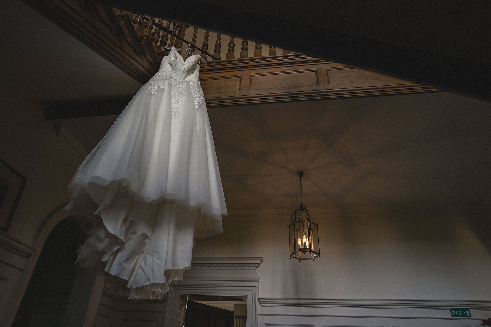 brides wedding dress hung up