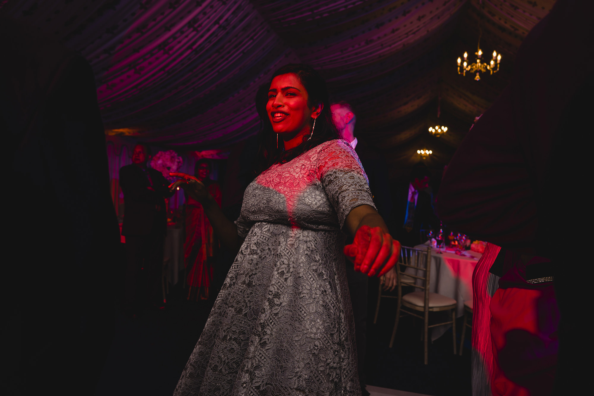 creative lighting of a friend at a wedding reception