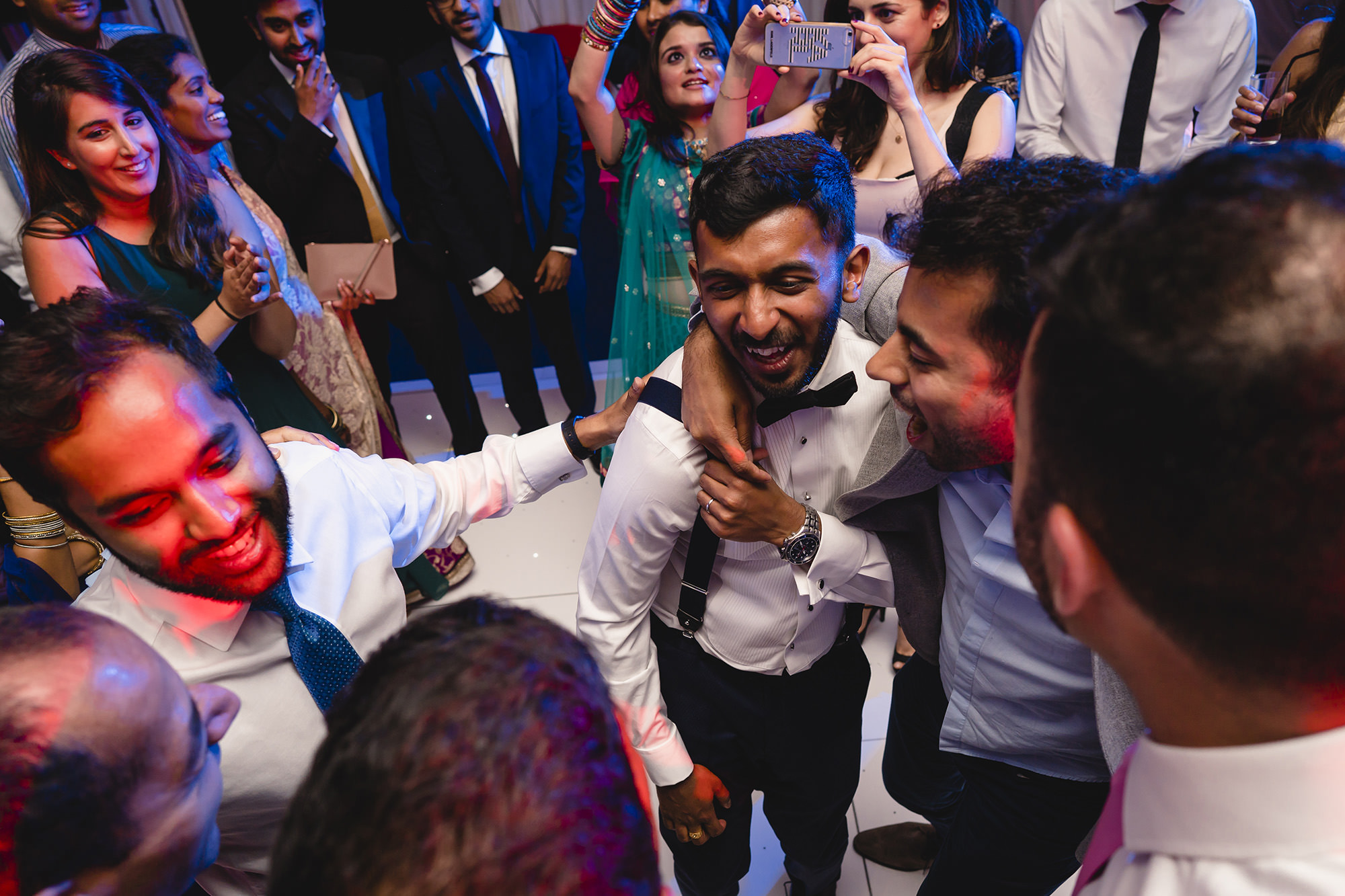 groom and his friends on the dancefloor
