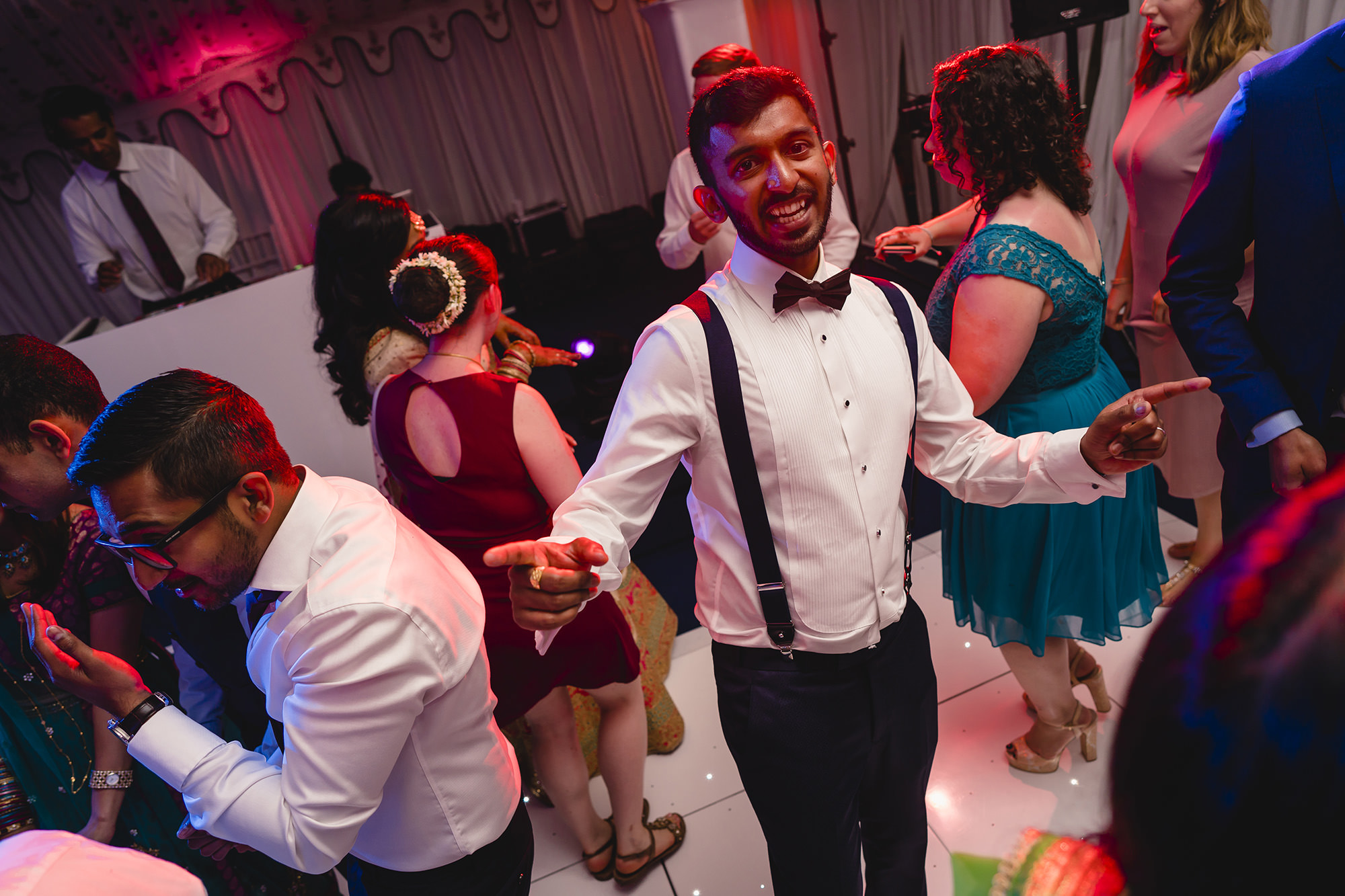 groom dancing at his wedding reception at poundon house