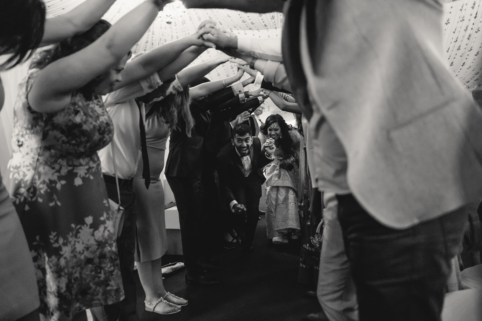 bride and groom tunnel exit at end of their wedding reception