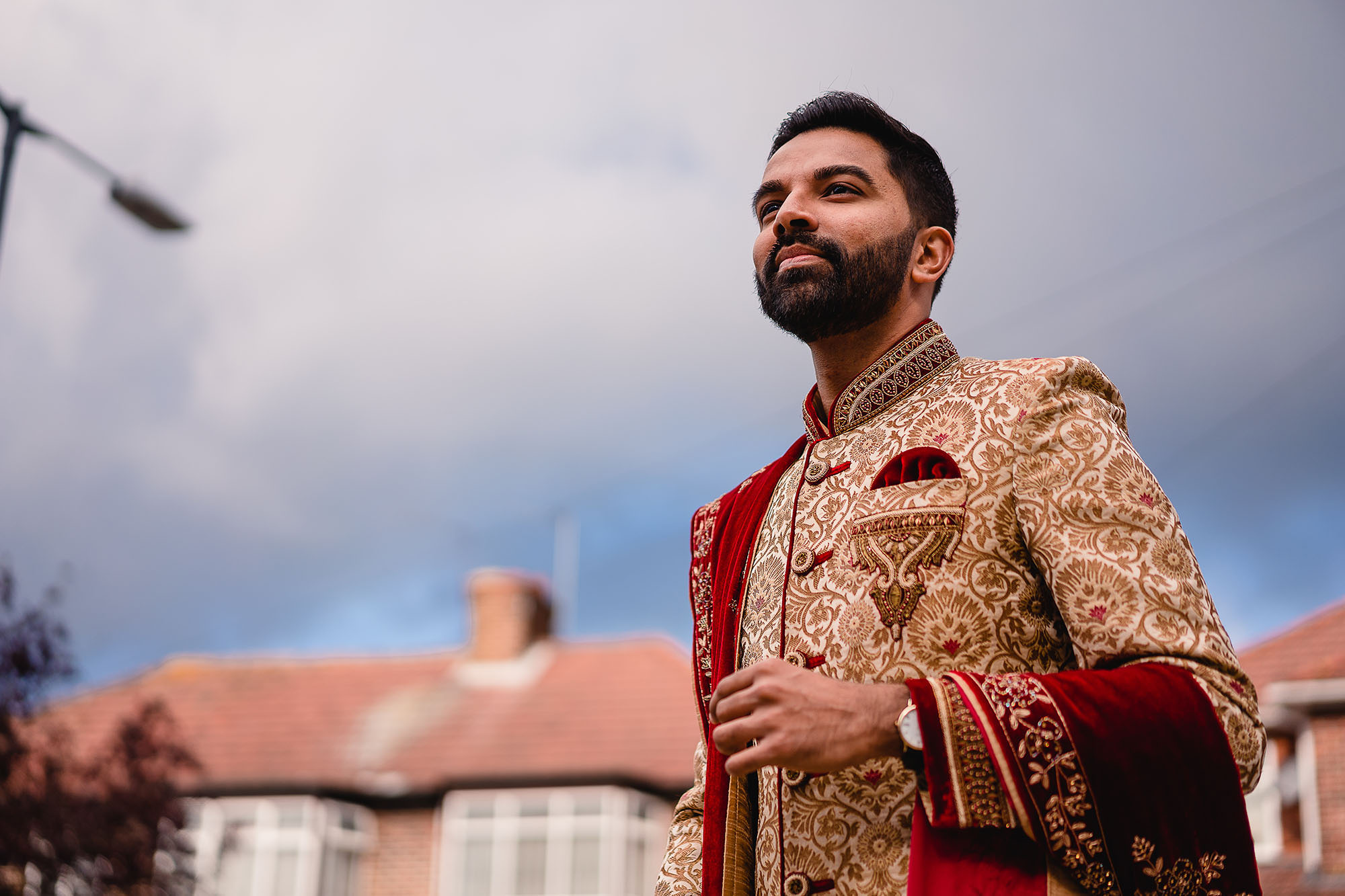 groom portrait in his indian wedding outfit
