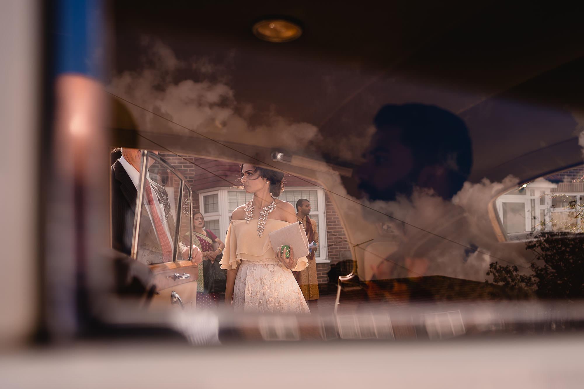 groom waiting in wedding car