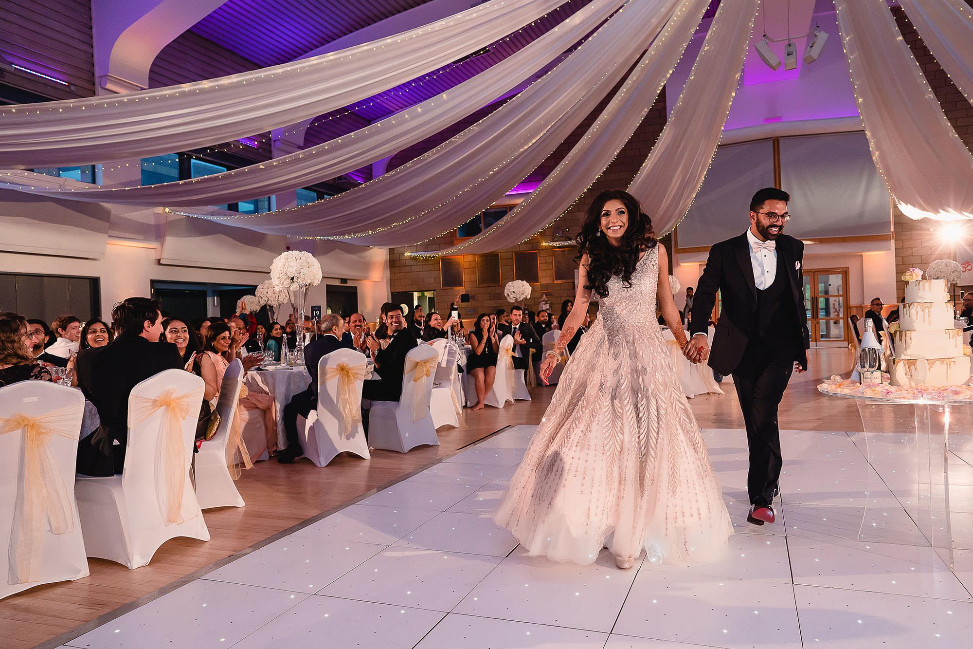 wedding couple entering their reception
