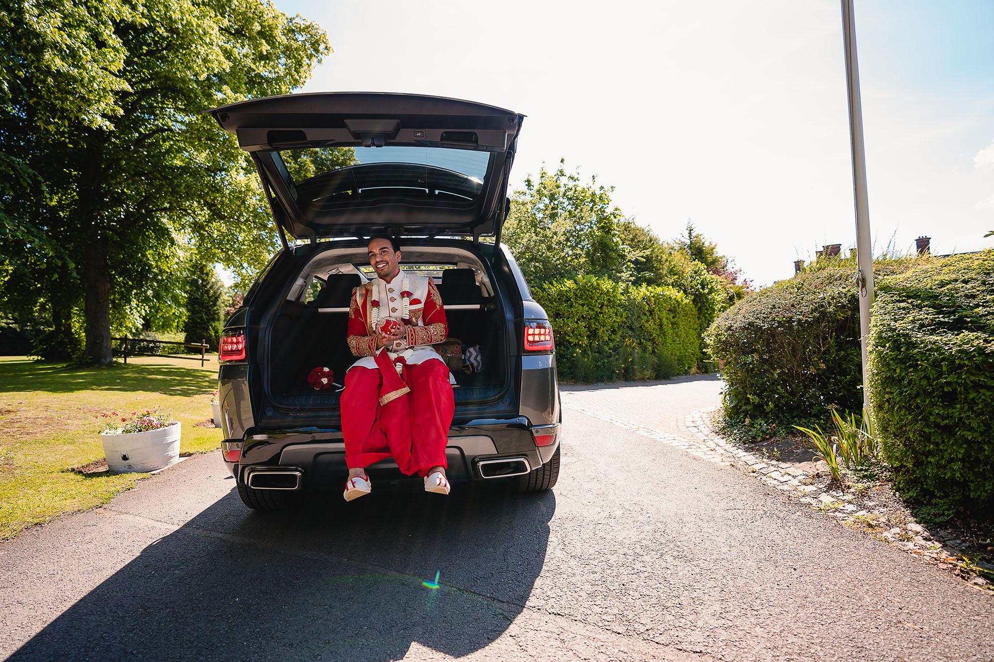 groom making his entrance in the back of his car