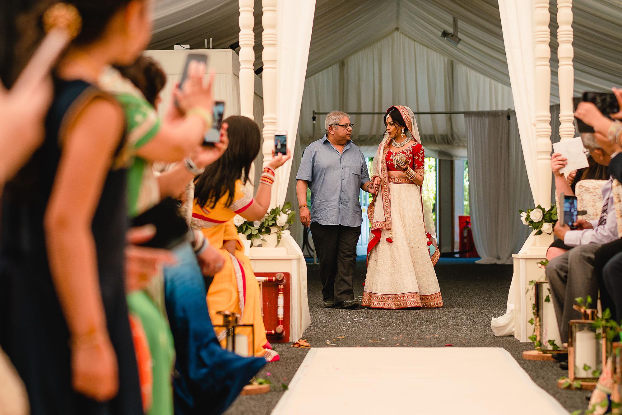 hindu wedding entrance of the bride