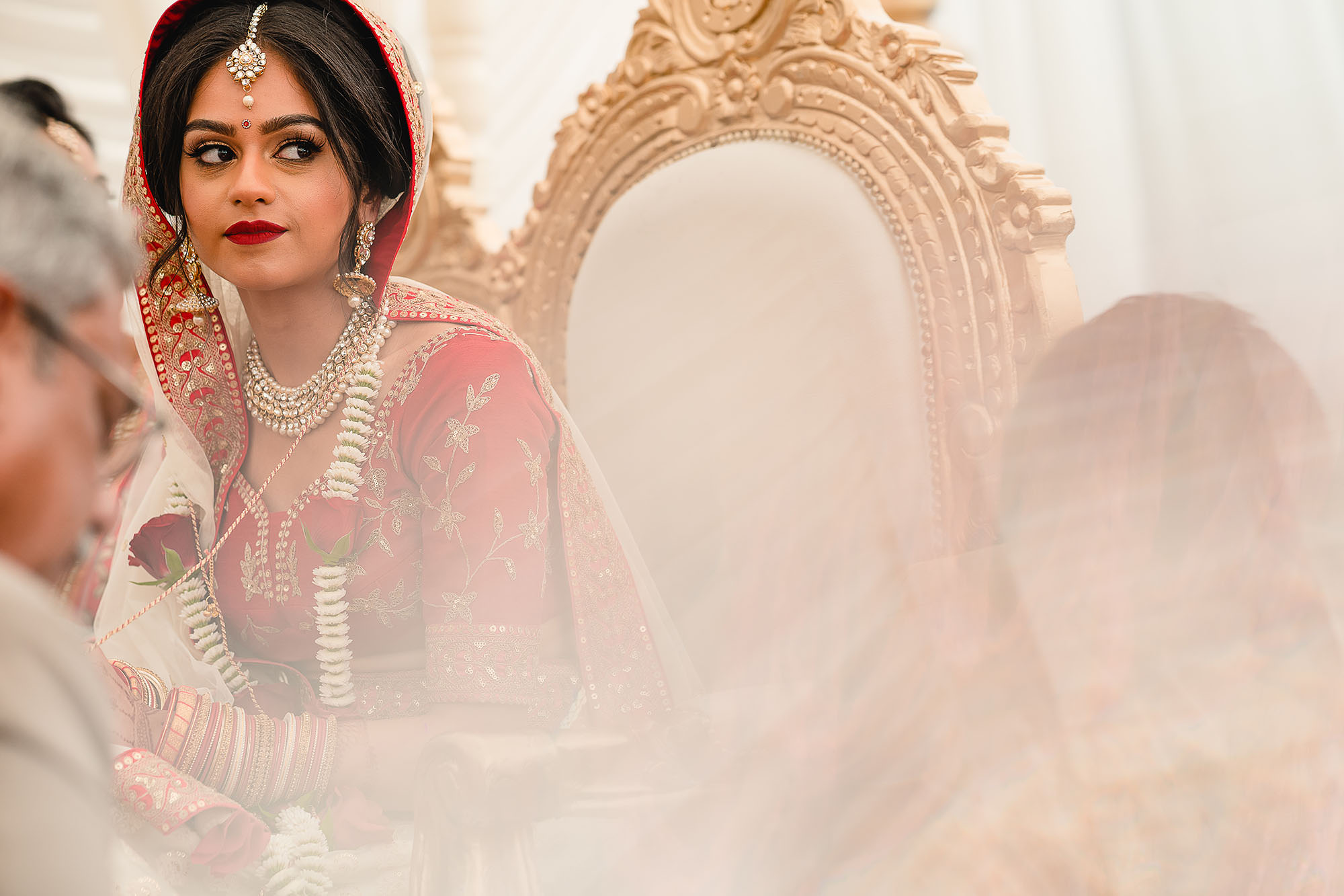 bride in mandap looking at guests