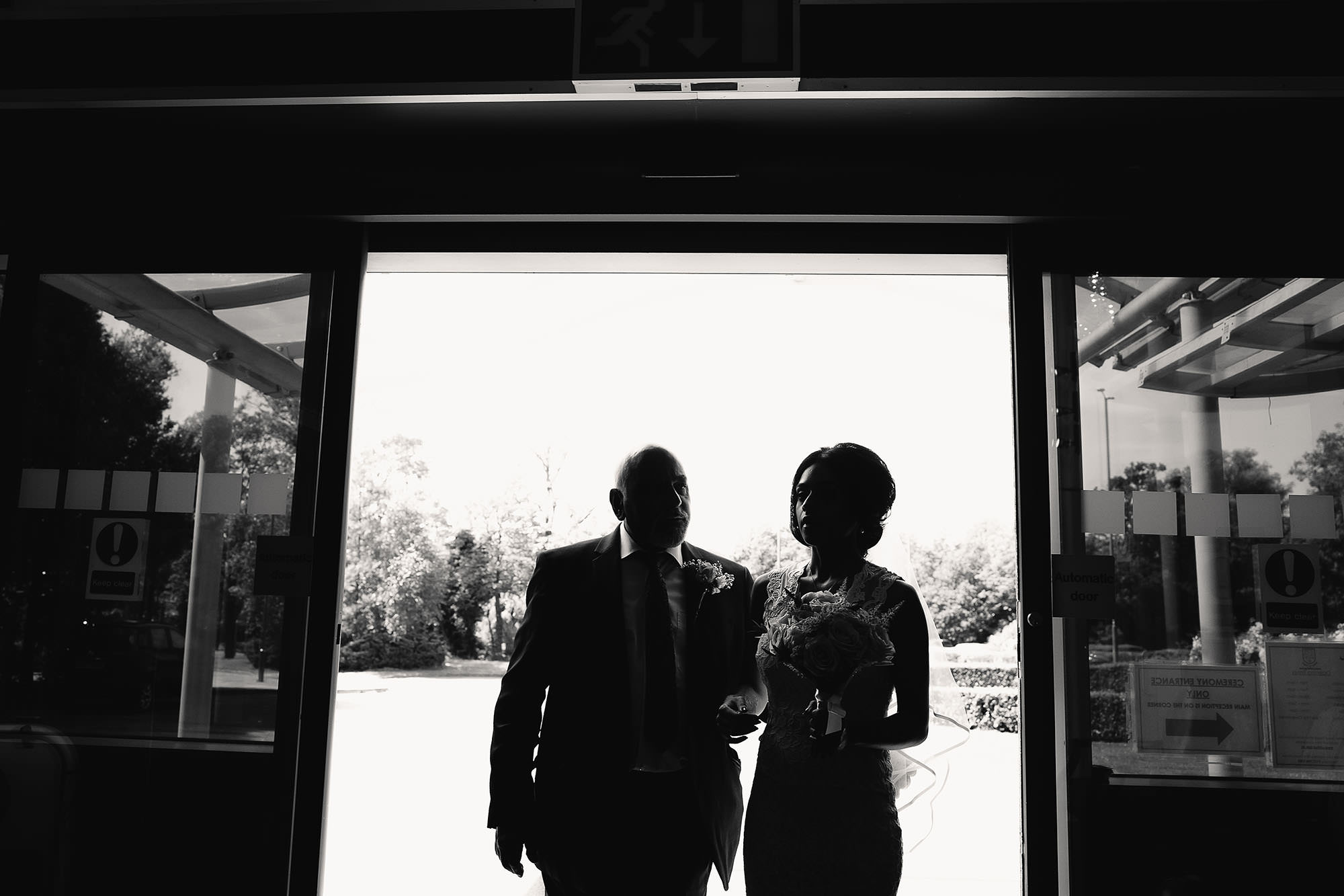bride and father silhouette before civil wedding
