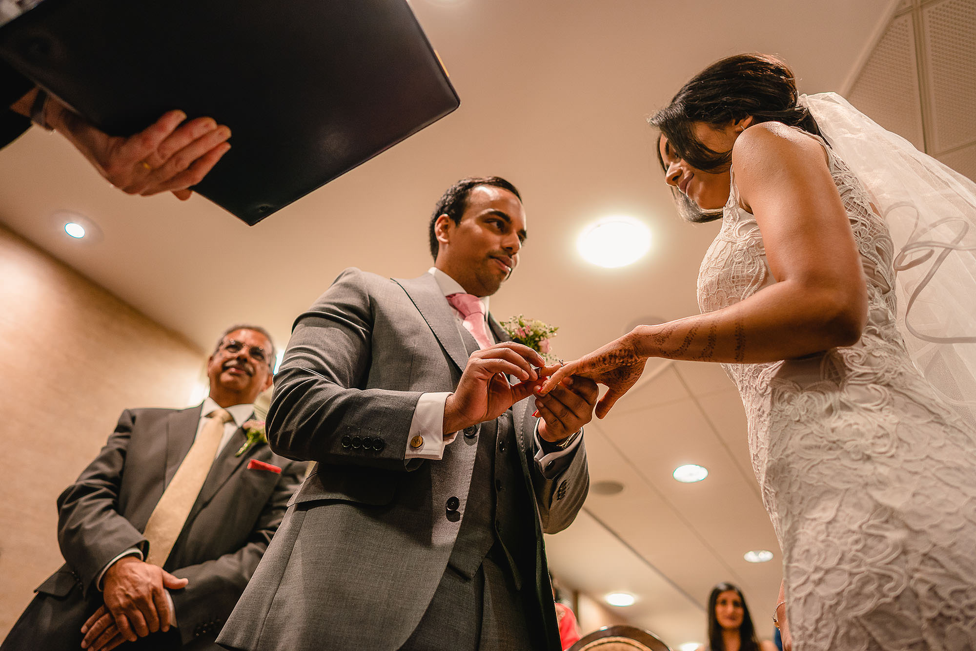bride and groom exchanging rinds during civil wedding
