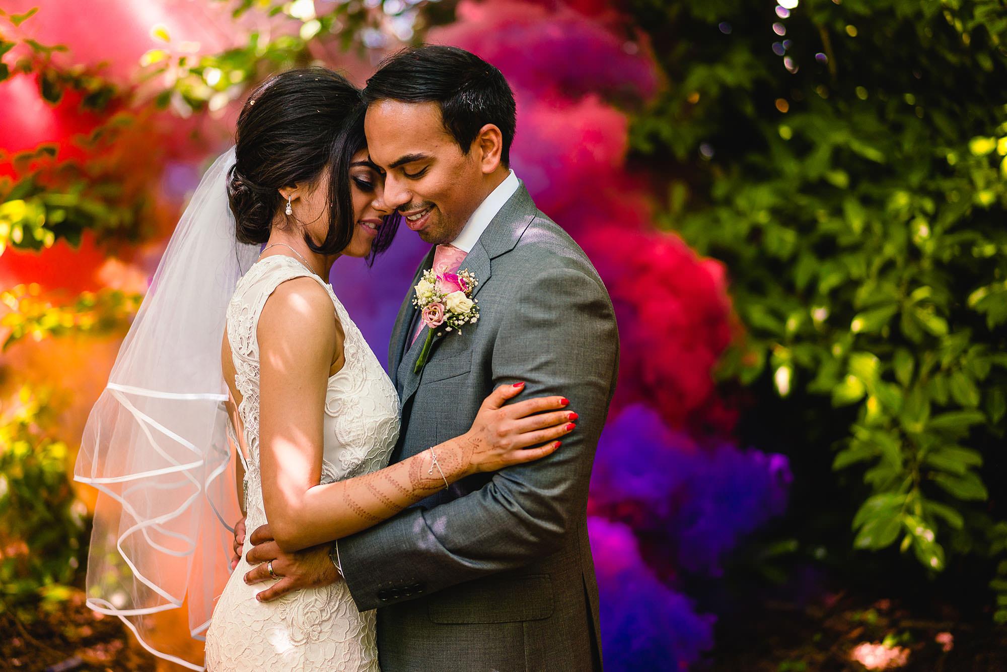 bride and groom with smoke flairs
