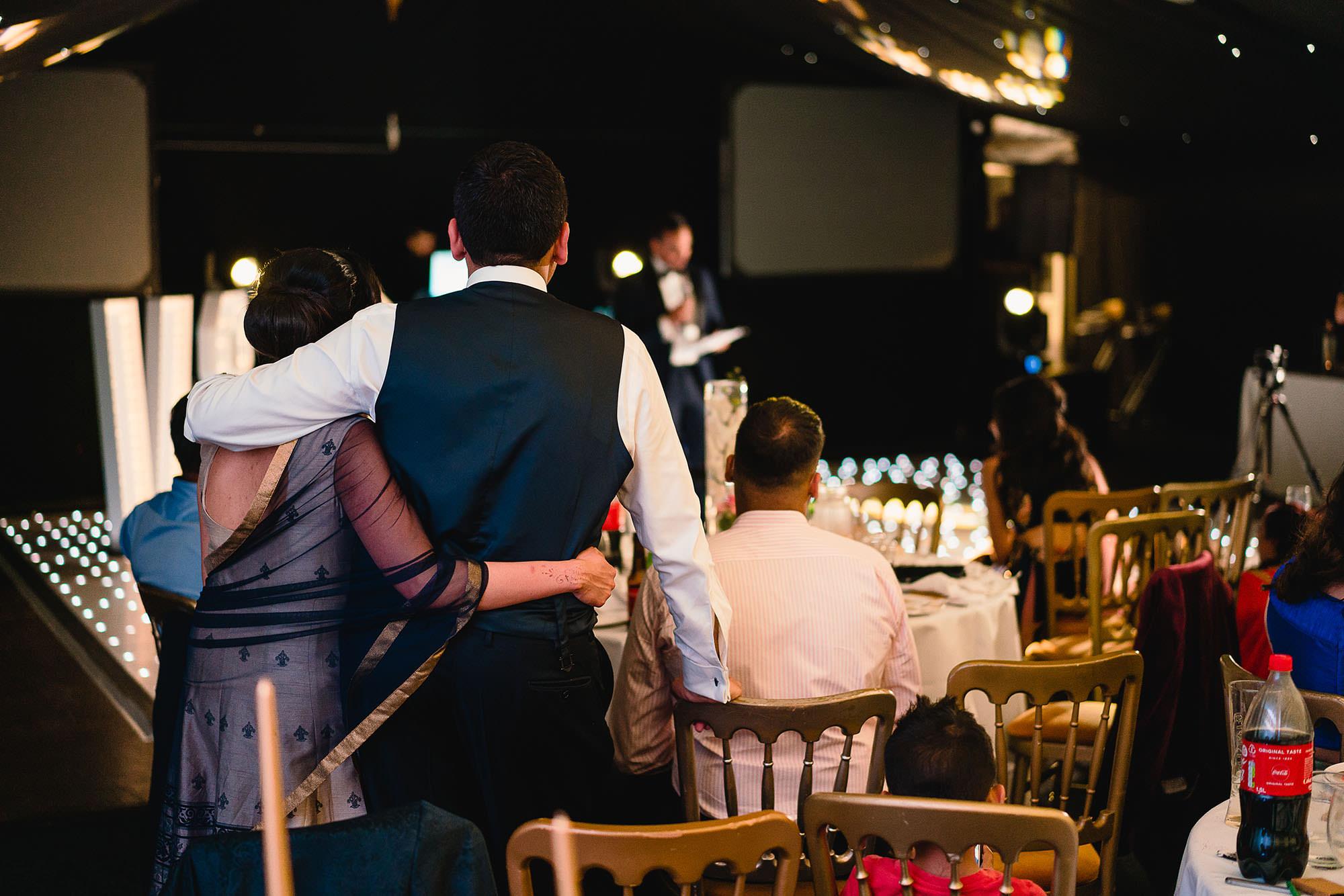 wedding guests watching speeches