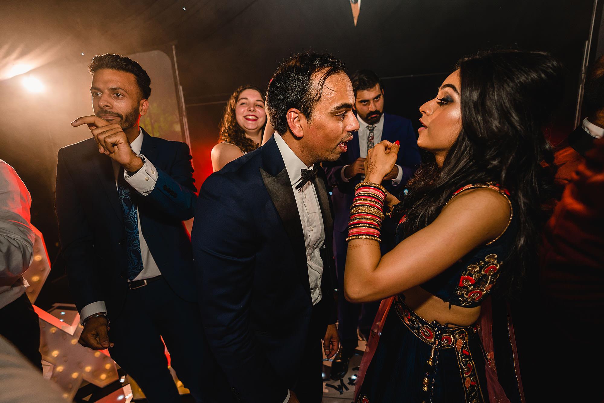 bride and groom on dancefloor dancing
