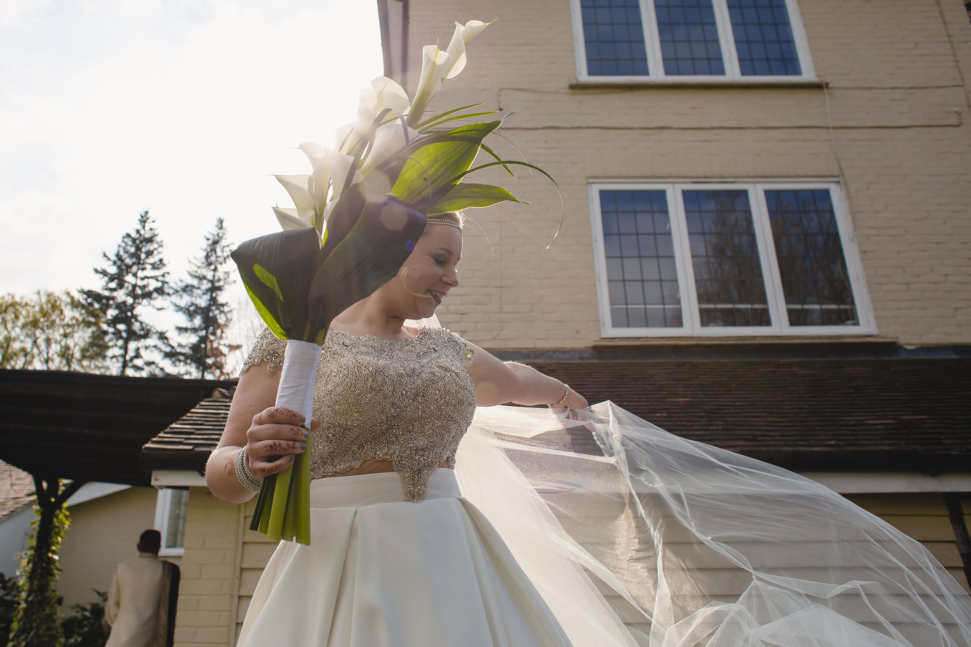 bride holding her bouquet and veil