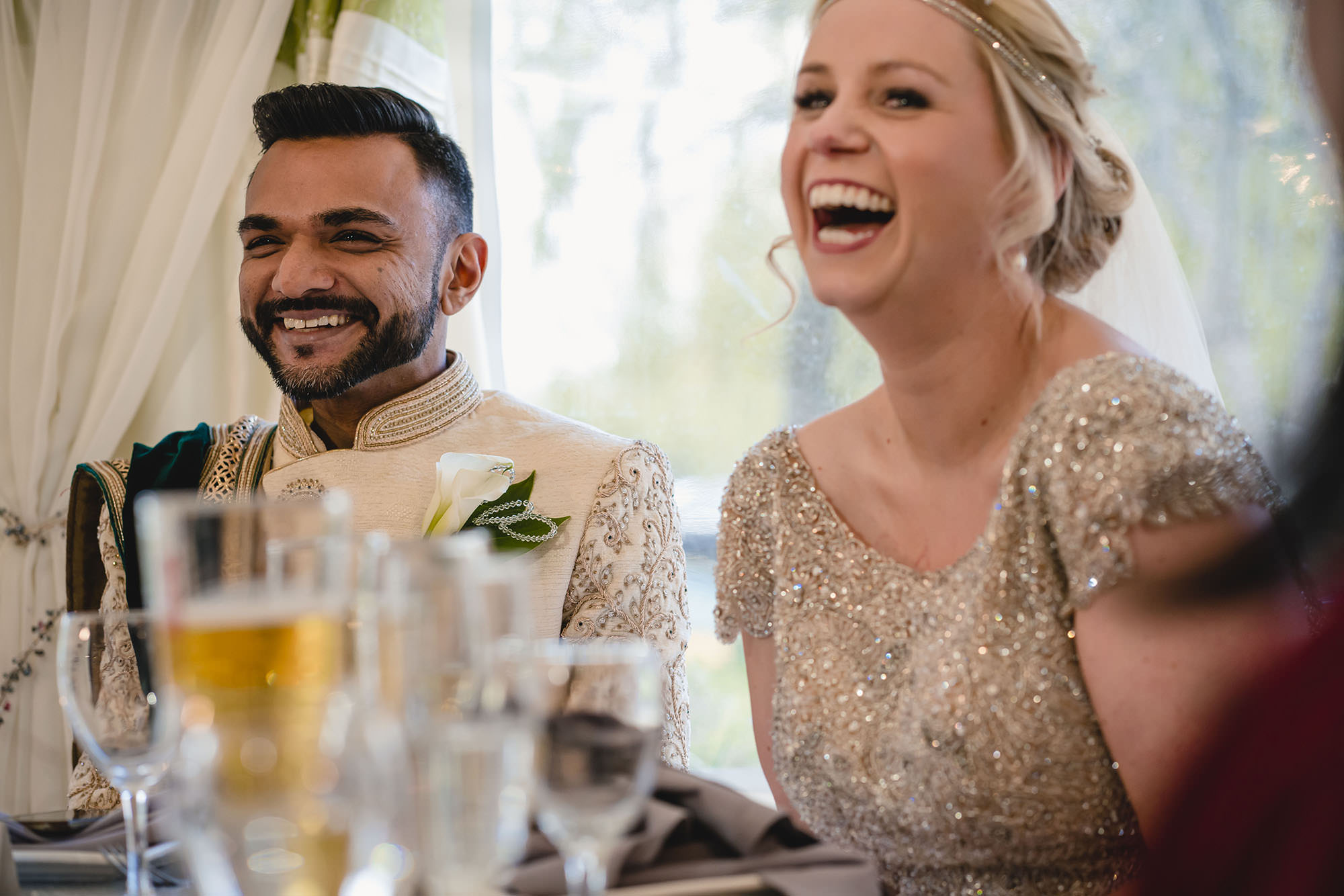 laughter of bride and groom during speeches