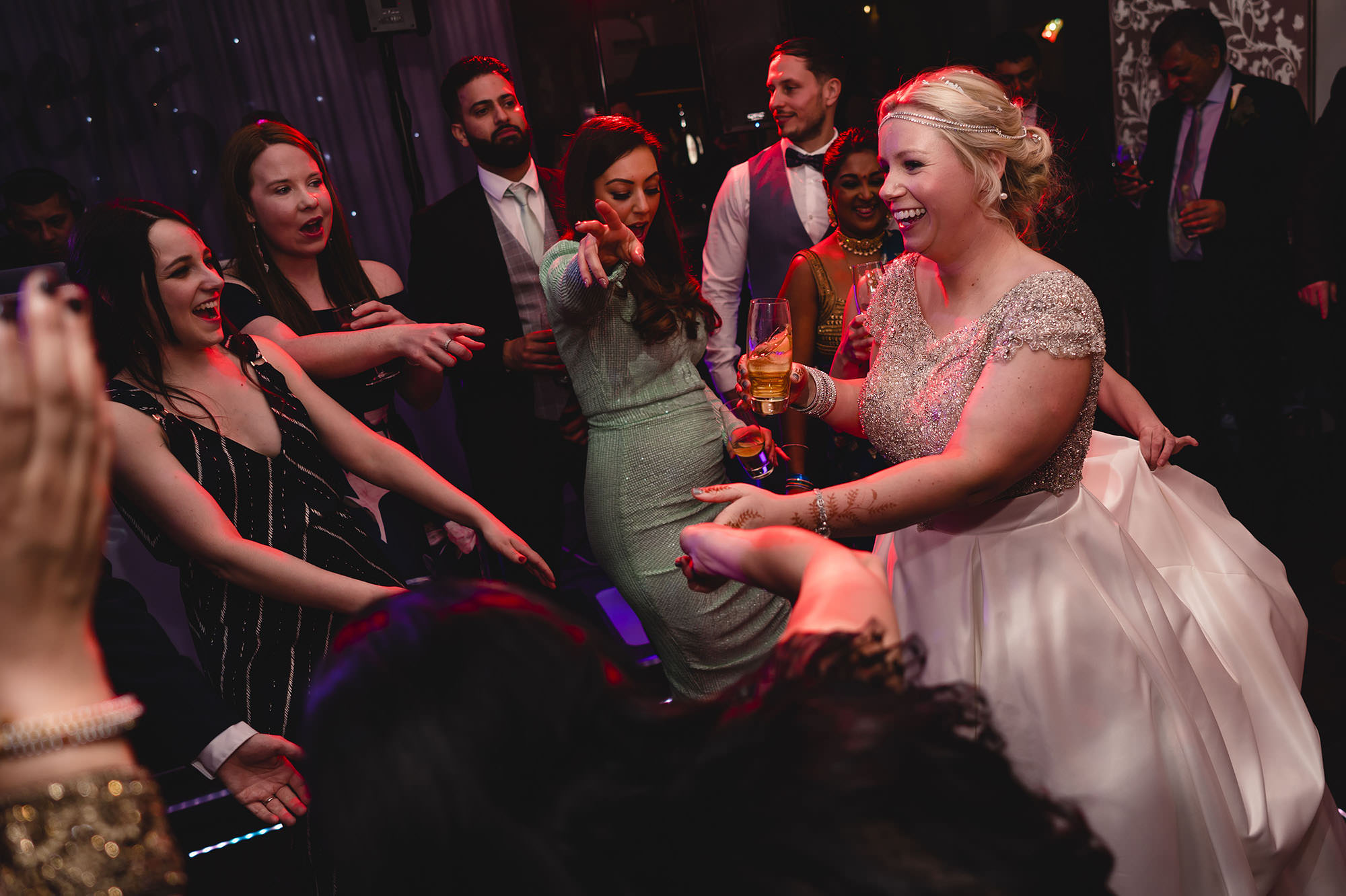 bride dancing with friends on the dancefloor