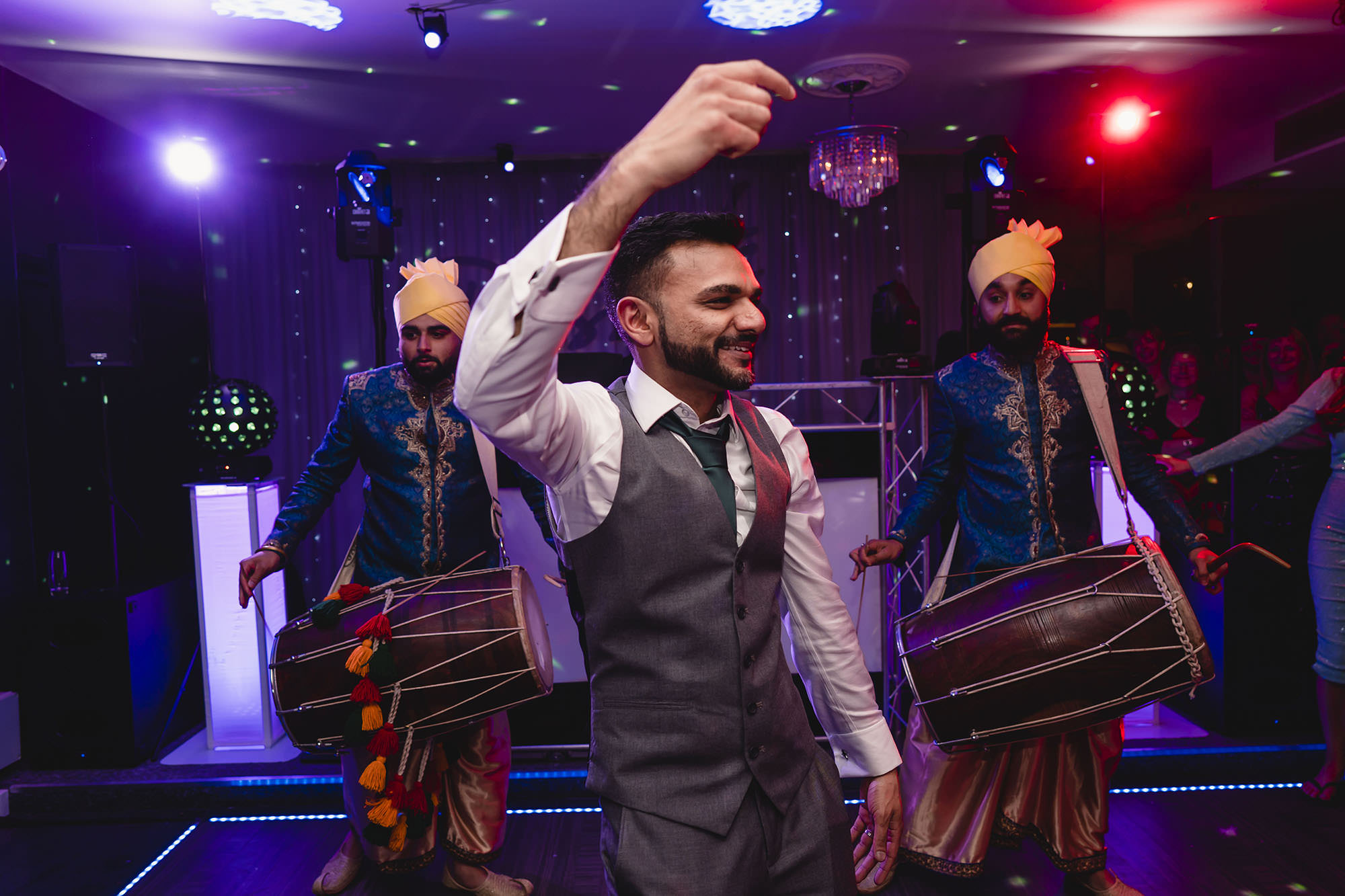 groom in front of dhol players at his reception
