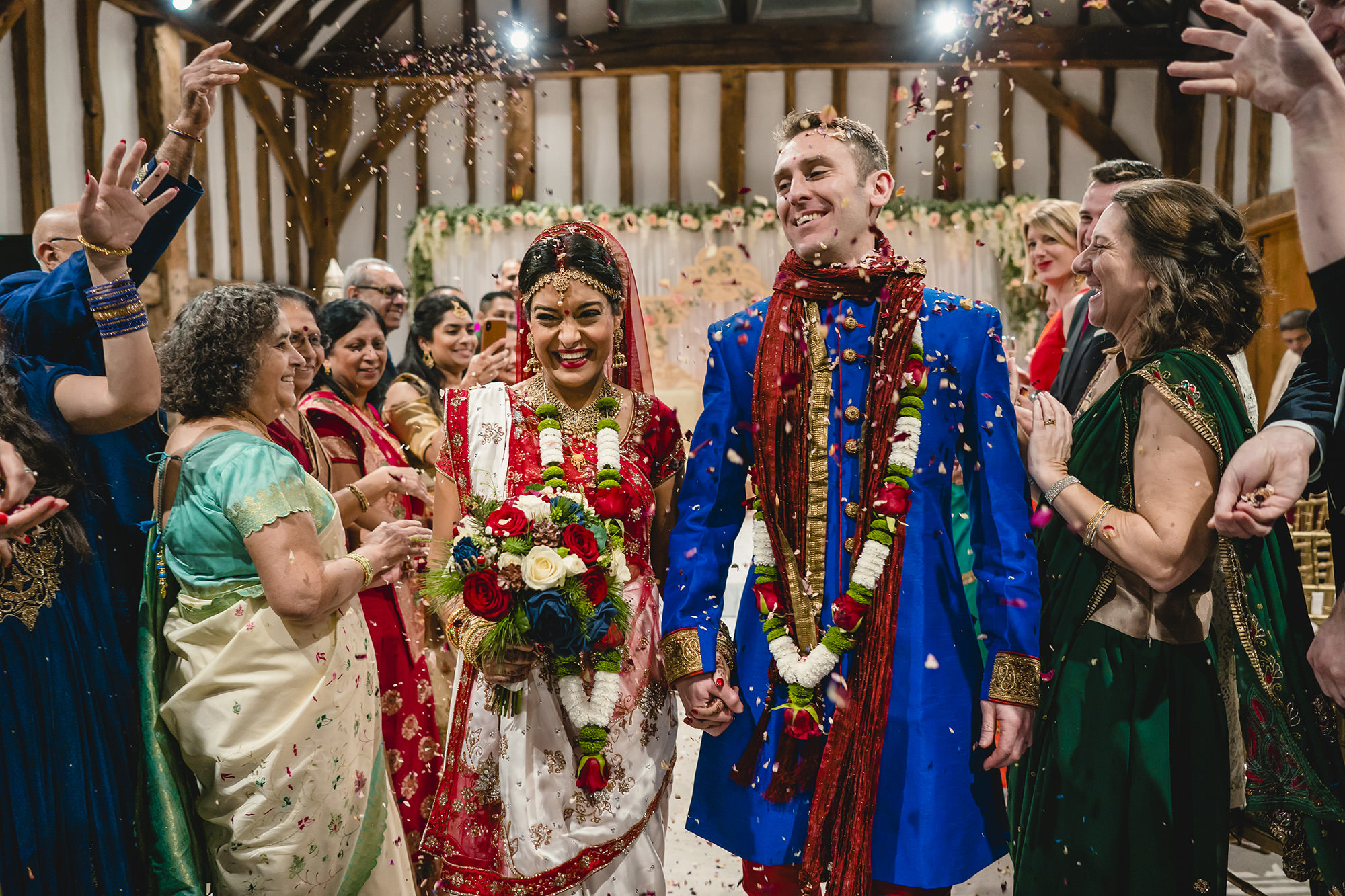 bride and groom confetti exit hindu wedding the great barn