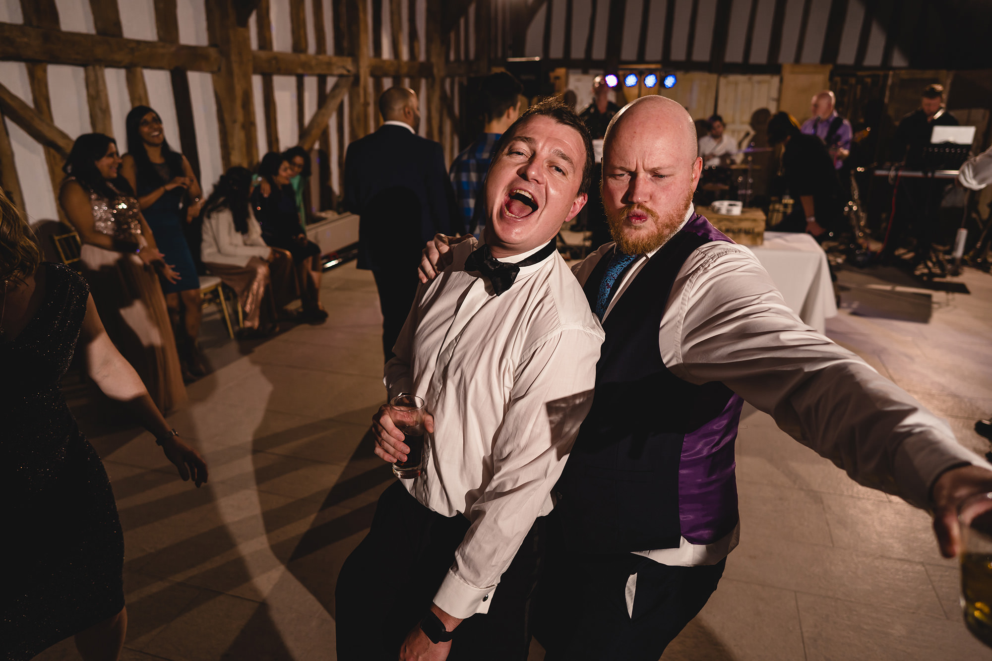 guests dancing at wedding reception at the great barn
