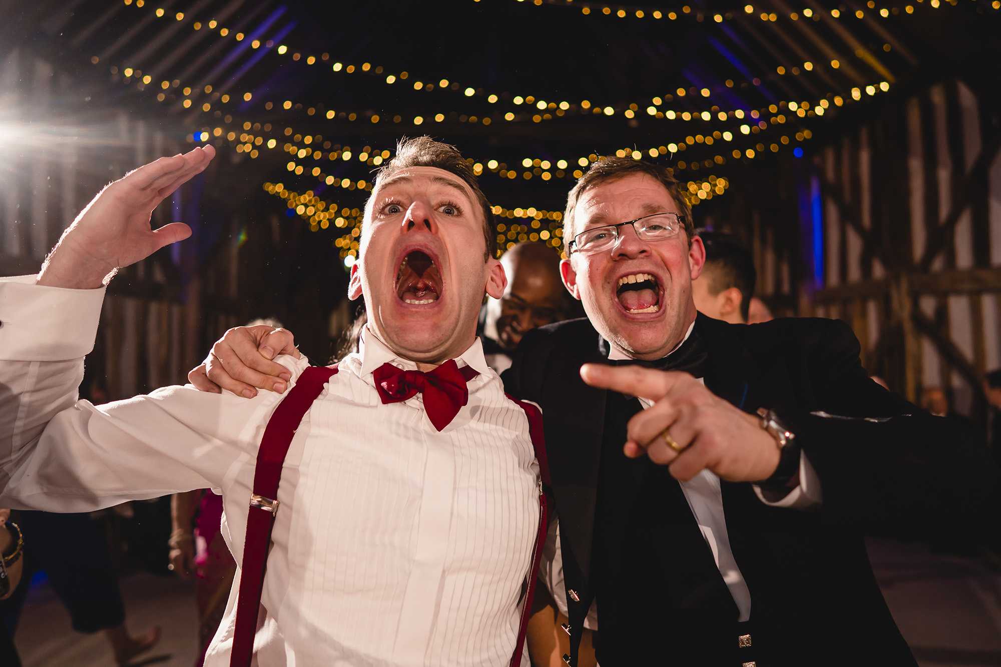 groom and usher partying at wedding reception