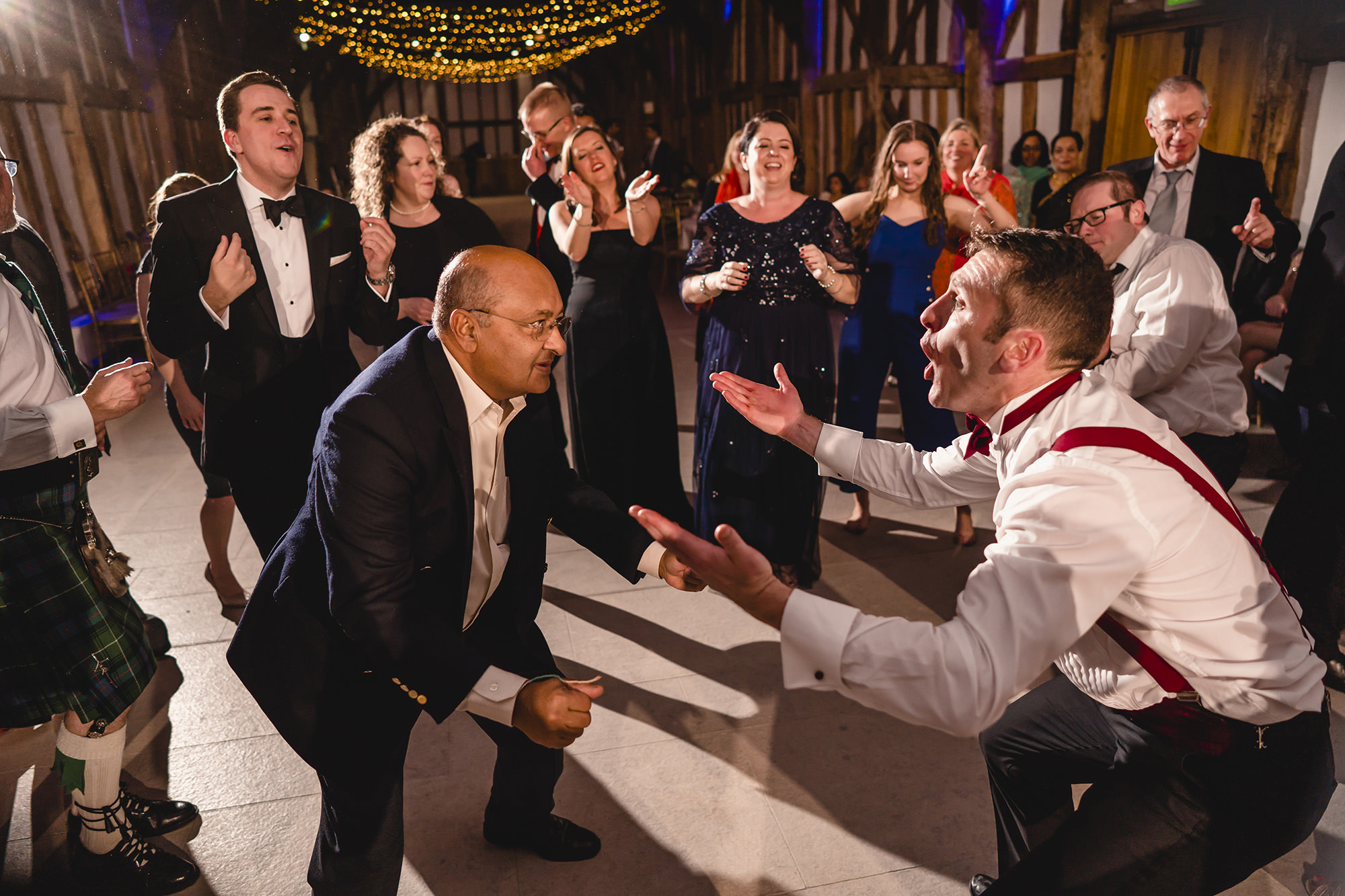 groom and father dance off at wedding reception